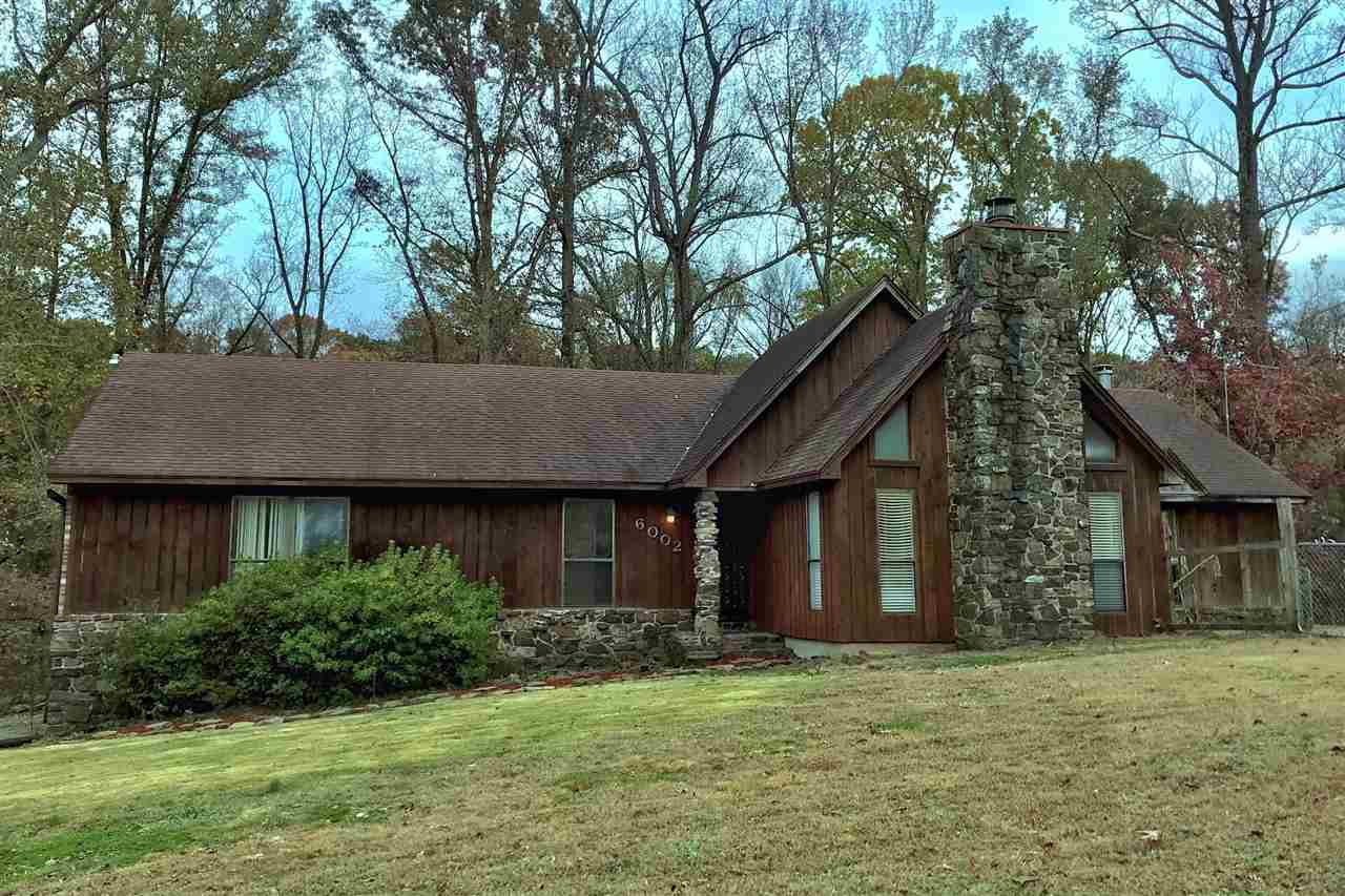 Private 4 acre lot near Shelby Forest.  County taxes only. 3 BR, 2 BA home includes heated and cooled Sunroom and Bonus. Oversized deck overlooks wooded area and provides a great space to relax and entertain. High ceiling great room. Impressive wood burning fireplace. Open kitchen includes all appliances. Separate breakfast and dining areas. Spacious laundry room w/built-in storage. Utility room off 2 car attached garage. All electric. Recent seller updates include baths and paint.