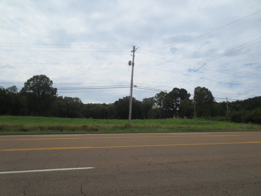 Property is combined 4 parcels totalling approximately 12.3 +/- acres.  Currently zoned AG land.  Trees, hills and level areas abound on this property.