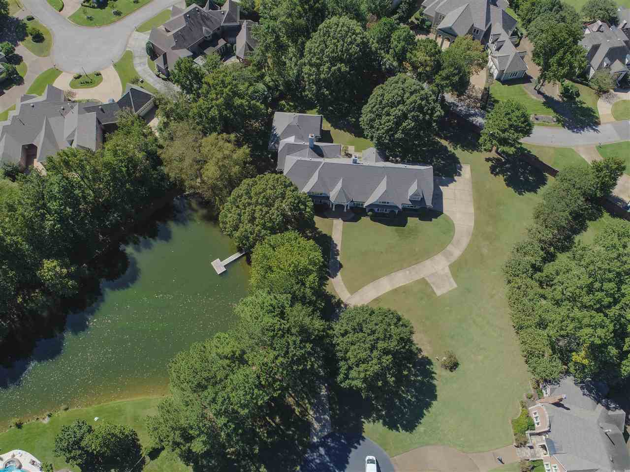 Relax and have family time on over 2 acres this property is nestled upon. Take a stroll along the walking paths and have a picnic in the common areas this spectacular gated neighborhood has to offer.