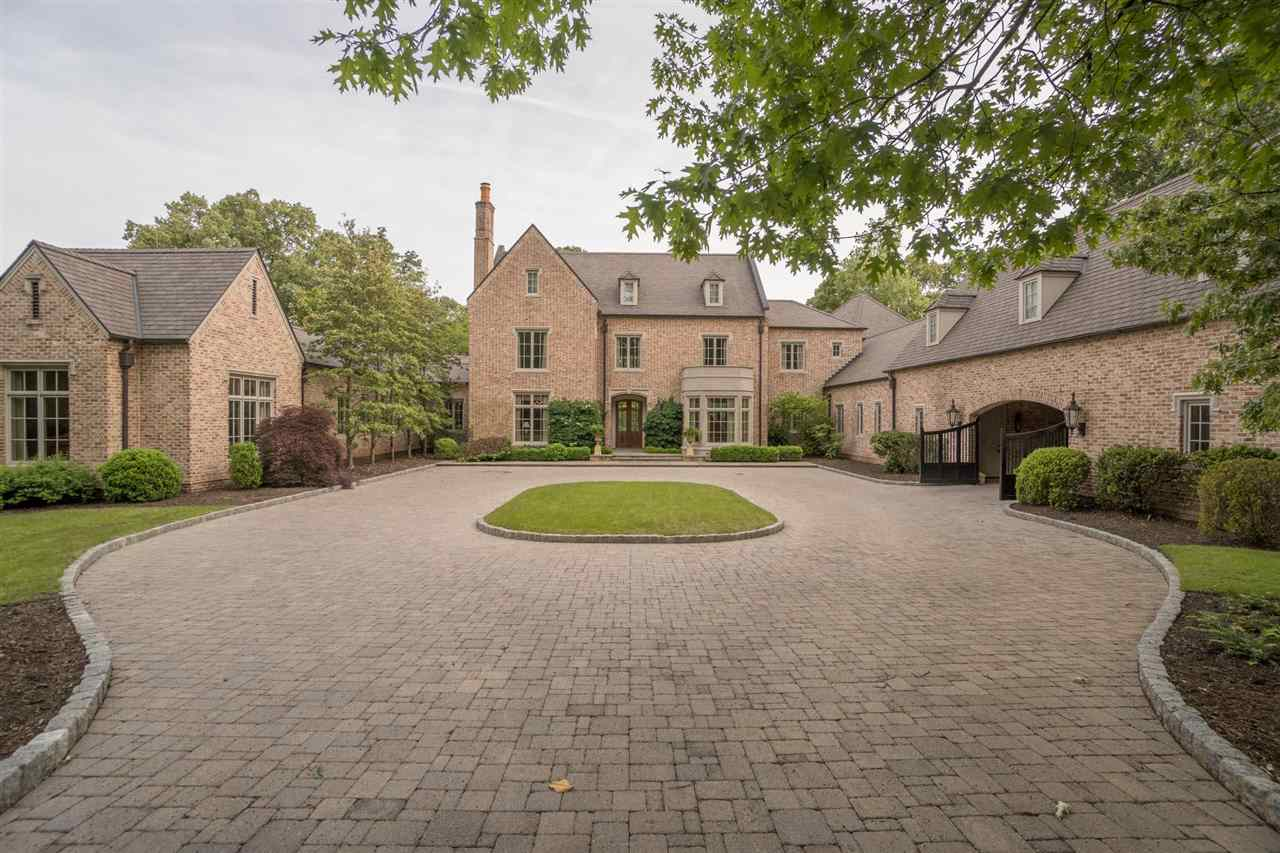 This home is a true masterpiece of design and details. Over 12,000 square feet of luxury within the Old Carolina Brick & Limestone facade. As the grounds green photos will be updated.  Rare opportunity to acquire a home of this quality in Memphis.