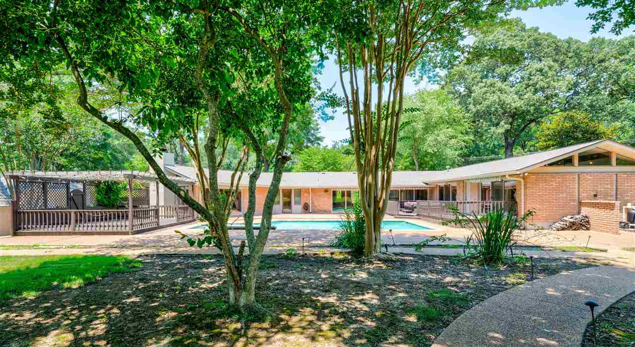 Rare Opportunity! Totally awesome Mid-Century Modern with Walls of Windows overlooking almost an acre of park-like rear grounds and sparkling gunite pool, expansive patio, and pergola-covered Party Deck. Perfect for entertaining or active family!