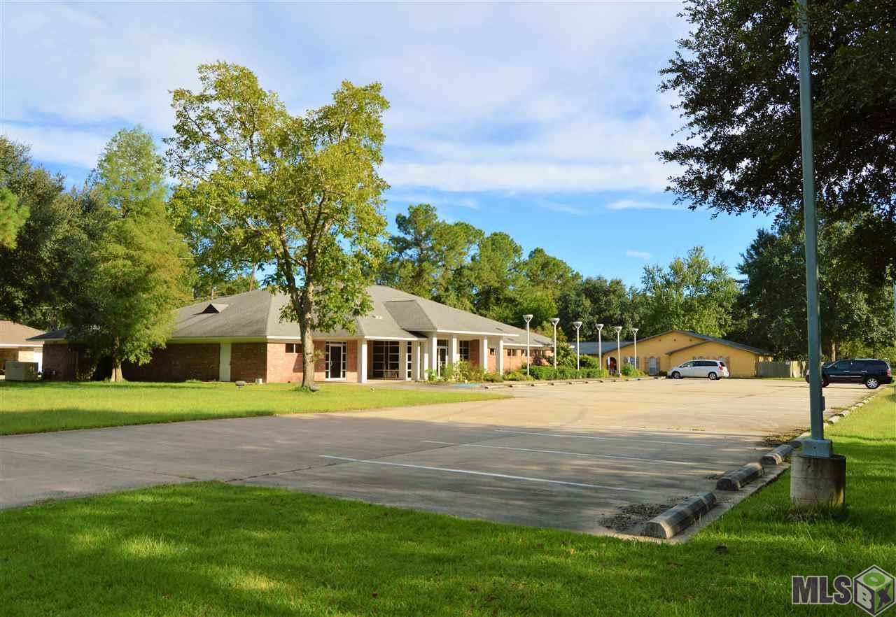 MEDICAL OFFICE/SURGICAL OFFICE located on LA HWY 30 in Gonzales, LA - between LA HWY 44(Burnside) and Airline Highway. Great location and investment opportunity!! Sale includes approx. 5.1 acres of land, 6,815sqft medical/surgical building, 35 parking spaces,  2,600 sqft home (could possible be used as an office) and storage building. Medical/surgical building includes 2 waiting areas, business office, 3 doctors offices, nurses stations, 10 exam rooms, x-ray room, 4 restrooms, 2 procedure rooms, pre-op & post-op areas, utility rooms, record room, storage rooms and gas generator. Less than half of the land is currently being used- plenty of room to add more parking and office buildings(with approval from the planning & zoning commission). Seller willing to lease back property for 1-2 years if buyer is interested