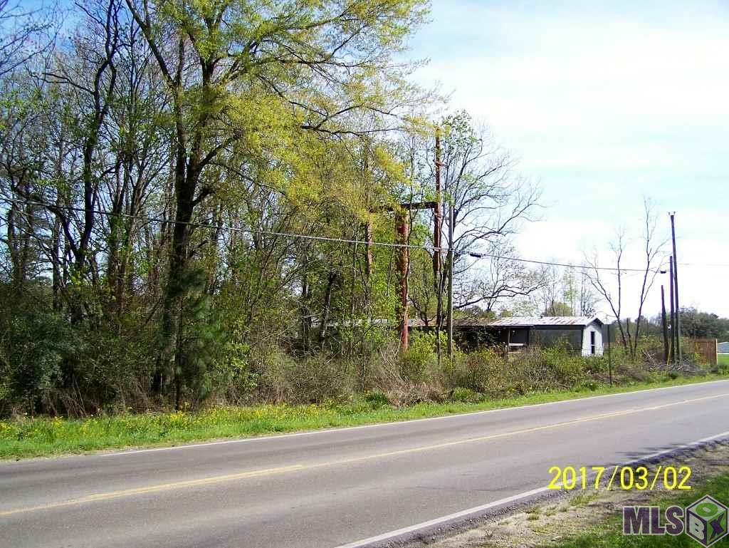 This tract is located at the corner of LA Hwy 16 (Pete's Hwy) and Cook Rd. by the new assisted living. Cook Rd. is projected to be thru to Juban Crossing. Great location for drug store, fast food, convenience store, and many other possibilities. Two buildings on property to remain at no value. Lot dimensions not warranted by Realtor.