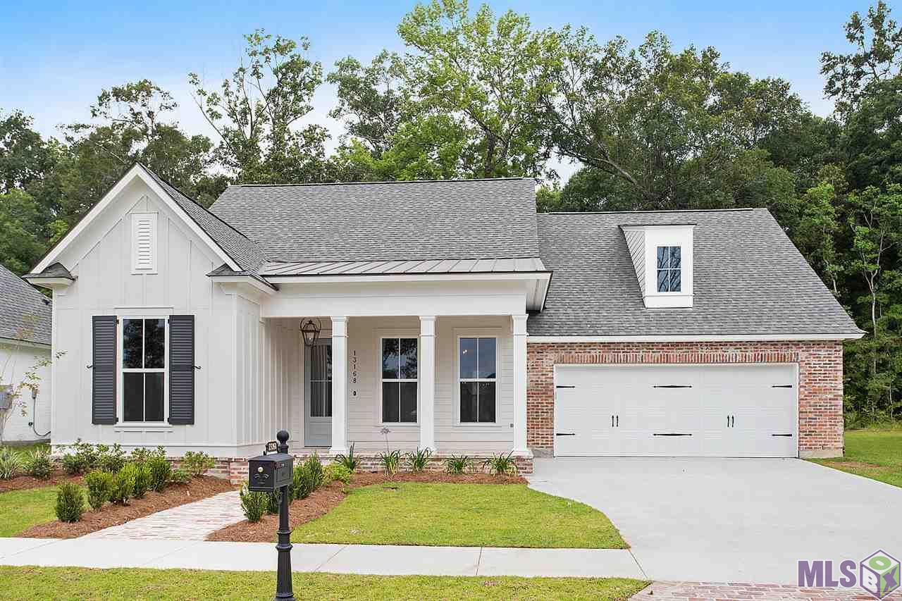 The Iris features 4 bedrooms and 3 full baths. You enter from the all brick front porch into a foyer with an architectural opening into the formal dining room. The butlers pantry connects the formal dining room to the kitchen, which is a great feature. The kitchen has a great eat in island and is open to the living room and back porch area. There are two bedrooms and bath off the front of the home and the 4th bedroom has its own private bath and walk in closet. The master suite has a spa like bath with double vanities , separate shower, and soaking tub. The laundry is spacious , and off the mud area which is located as you enter off the garage. This plan is well thought out, lives well and great for entertaining. This home has a lot of upgrades such as speciality mud room cabinets, upgraded stone countertops, rectangular vanity sinks, wood in master bedroom, living room, dining room, and kitchen areas, upgraded lighting and hardware packages.  This home is a showplace!
