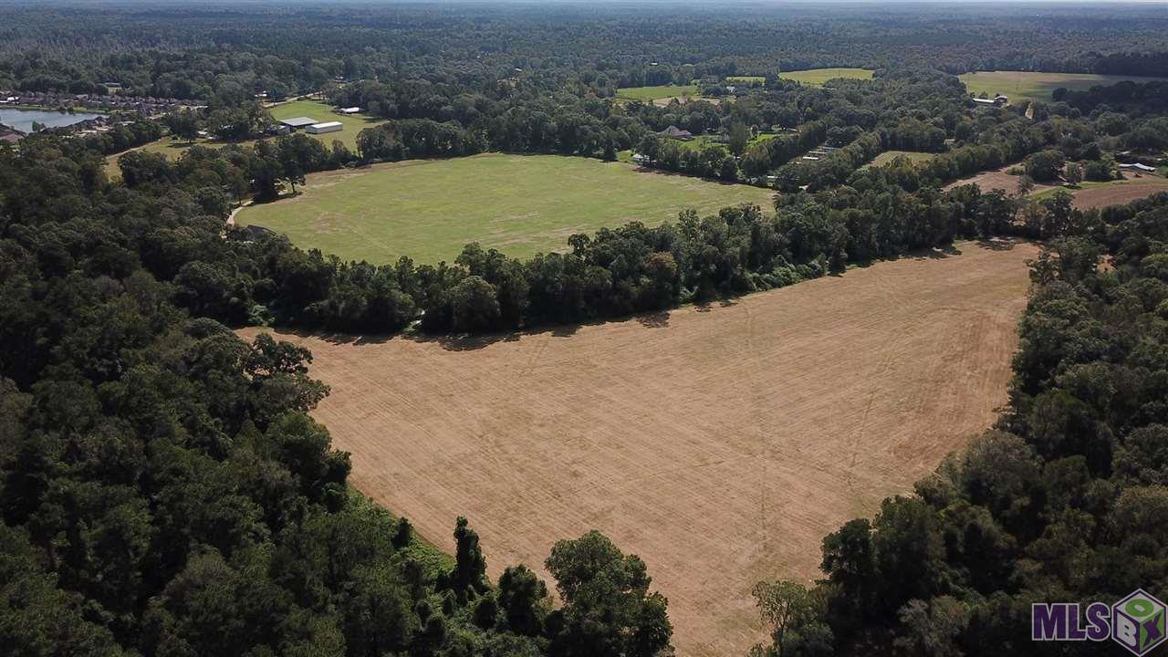 Prime development opportunity in highly desirable South Denham Springs. Only 5 miles from Juban Crossing I-12 & 5.4 miles from I-12 exit at Range Ave. Mostly pasture land hay fields. 55 acre tract can be sold separately for $1,308,480. Access frontage negotiable. 3BR 3.5 bath with 2400 LA home, (1) 60x100 building, (1) 50x100 building, & pole barn with workshop. Unlimited potential. 60x100 could be used as a horse riding arena w/ overhang being converted to stalls. Potential uses include wedding & event venue. Must see this beautiful tract! *Lot dimensions not warranted by Realtor*
