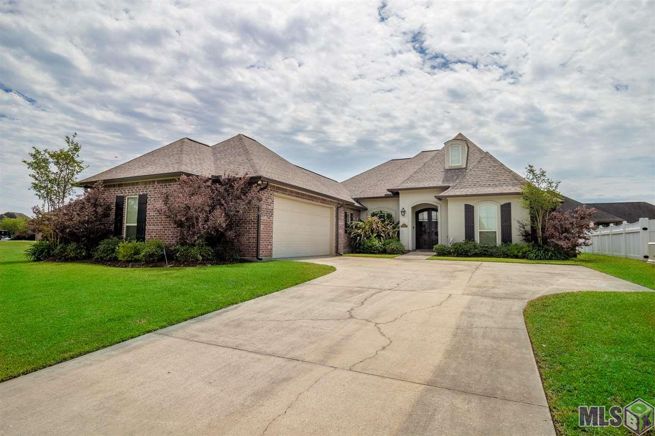 Wonderfully kept 4 bedroom French style home with views of the lake.  Too many features to name!  Triple floor plan.  Kitchen with granite countertops, stainless steel appliances, gas cook top and views of the water.  Kitchen, living and dining are all open to each other.  Large living room with hand scraped hickory laminate flooring.  Large master w/ huge master bath that has garden tub, separate shower, double sinks and extra dressing area.   Views of the water from the backyard and greenspace right next door.  Great for added privacy or entertaining.