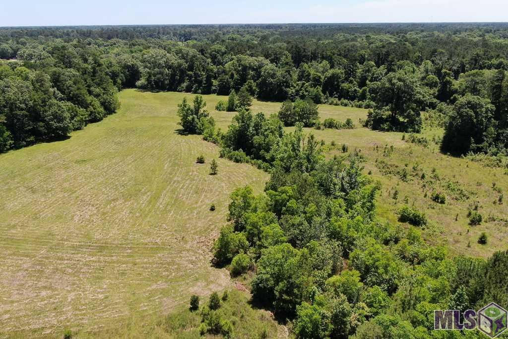 Beautiful 93.35 acres of Investment Property, available in the highly desired South Denham Springs. This large tract of land is perfect for a subdivision with over 1000+ feet of Hwy. 16 road frontage and big enough to allow generous size lots for spacious homes. The possibilities are endless. The majority of this land is cleared pasture with only pockets of wood. The rear backs up to Stone Bridge subdivision. There is an older home on the property that was flooded and will remain at no value. Property may only be visited by confirmed appointment and with listing agent present. Schedule your showing to see just how beautiful this rare find land really is!