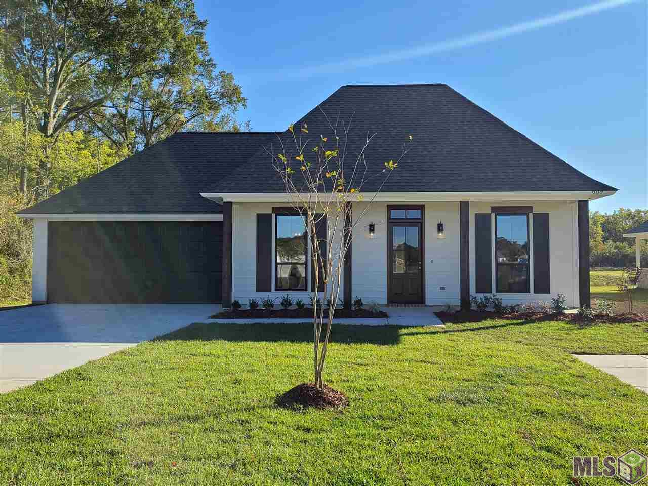 "Pre-Sold Home sold before listing in **Arbor Crossing by Trinity Construction**  Pick your lot and plan and sign contract to build your new custom home by Jun 31st to receive free Frigidaire SS Side x Side Refrigerator & 2"" Blinds Throughout**  3 BR 2 Bath by Trinity include features such as - Stainless Steel Appliances, 3 cm Slab Quartz or Granite Countertops, Custom Tile Backsplash, Deep Single Bowl or Dual Undermount Kitchen Sink, Custom Wood Cabinets, Pull-out Drawer for Trash Can. Bathrooms - Your choice of Oil Rubbed Bronze or Brushed Nickel Fixtures, 5' Soaking Tub in Master and Separate Custom Tile Shower. Flooring - Rigid Core Vinyl Wood Plank Flooring, No Carpet. Outdoor Features - Brick, Stucco and Hardi-Plank Siding per plan, Cypress Posts and Window Lintels per plan, Professionally landscaped & sodded front yards, Custom Wood Front Entry Doors, 30 Year Architectural Shingles. Efficiency Features - 50 Gal Energy Efficient Water Heater, Radient Barrier Roof Decking, 14 seer energy efficient forced-air cooling w/gas furnace, R-13 Insulation Walls & R-38 in Attic, Water Management Faucets - Dishwashers - Toilets, LED Disk Lights thru-out (per plan). Beautiful Lighting Packages in Oil Rubbed Bronze or Brushed Nickel finishes, Ceiling Fans w/light kit in Living Room & all Bedrooms, Patio Pre-wired for Ceiling Fan, Decorative Chandelier in Dining.  Miscellaneous - Smoke & Carbon Monoxide Detectors, Cat5e & Cable Connections (per plan). Pre-wired for Security and each home comes with a Security System Package w/2 years of monitoring (Restrictions Apply).  9, 10, & 11 Ft Ceilings (per Plan),  5-1/4"" Crown Molding in Open Living area and all rooms,  5-1/4 Base Molding throughout, Decorative Wood Beams (per plan) & Ventless Gas Fireplace w/ Wood Logs & Mantle."