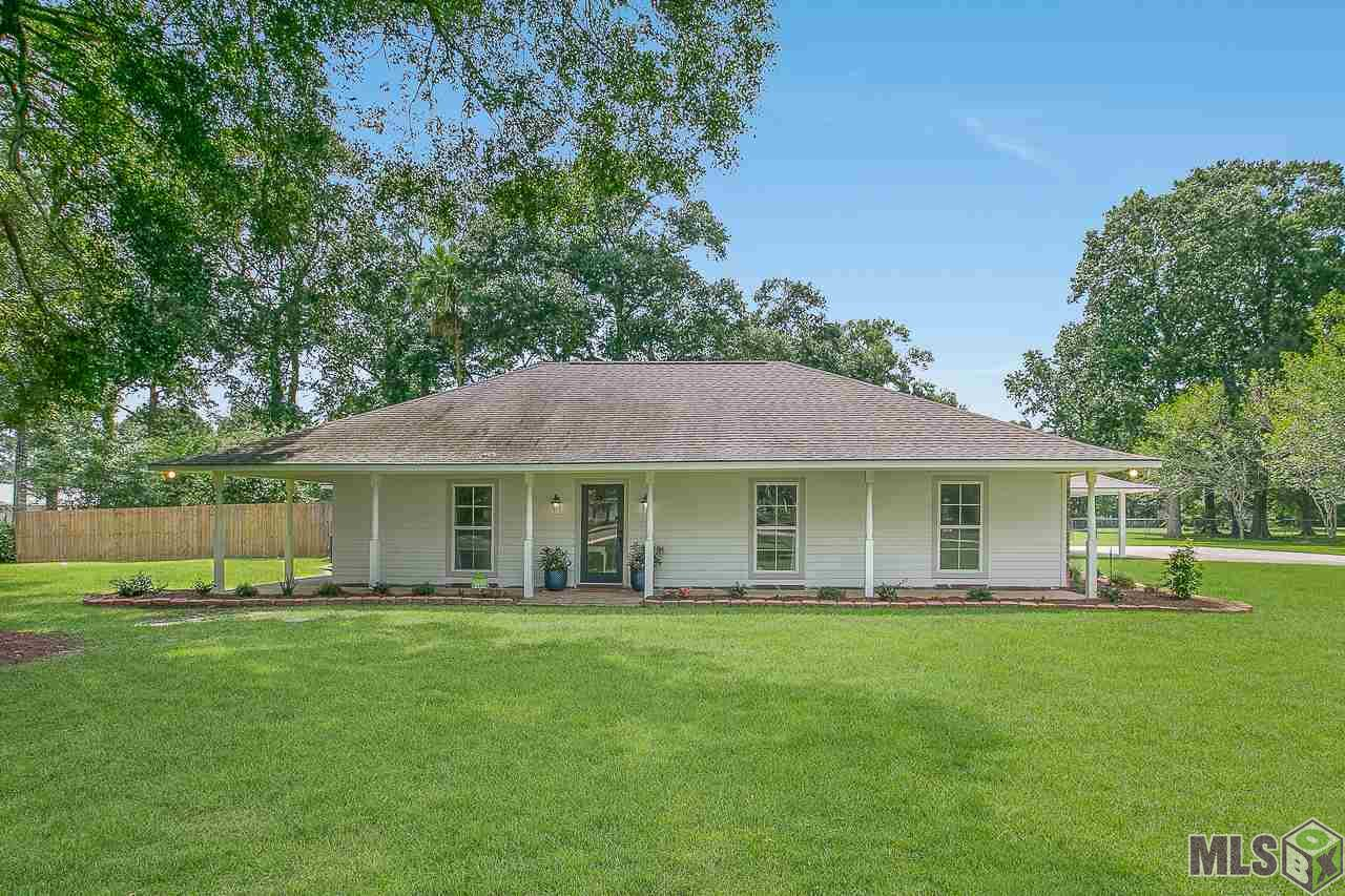 Don't miss your chance to buy an updated home on acreage with a pool!  This beautiful 4 bedroom 2 ½ bath home PLUS large bonus room is too good to pass up.  Walking into the living room, you immediately notice the vaulted ceilings, spacious layout, and the gorgeous brick fireplace.  The kitchen boasts white cabinets, granite countertops, and eat at breakfast bar, stainless appliances, a double oven, and a window over the sink.  There is a breakfast room off of the kitchen with beautiful bay windows as well as a large formal dining room with French doors.  Off of the kitchen is a large walk in pantry, a separate butler's pantry/workspace, a spacious laundry room, and a half bath complete with white shiplap walls.  The primary bedroom is a great size and has two walk in closets and an ensuite bathroom with two sinks. This home also has 3 more spacious bedrooms, another beautiful full bathroom, great closet space throughout, and a large bonus room that opens up to the back yard. The property is a dream.  It is fully fenced and boasts a large swimming pool, a covered patio with fans, a large storage room, and an extended driveway for ample parking.  This home has never flooded and is located in the Central school district.