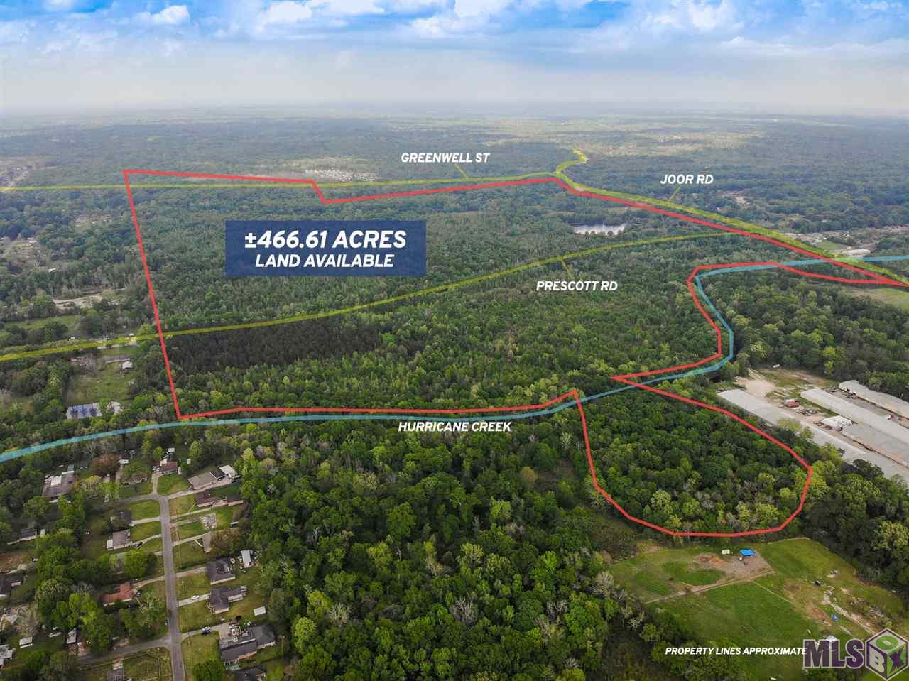 All property boundaries are approximate.  Located just north of Greenwell Springs Road and bordering Joor Road along the drive into Central City lies this large, ±466.61 acre development tract. The tract borders the edge of existing development in the northeastern sector of Baton Rouge. The property itself lies just outside of the Baton Rouge city limits.  The property is mostly wooded but also contains a few ponds and clearings. Two creeks run through the property (Hurricane Creek and Roberts Canal) and Greenwell Street and Prescott Road both run east/west through the tract. Also existing on the property is a pre-Civil War house in need of restoration.  The property is an excellent tract for recreation while presenting the opportunity for future development.  It is currently zoned A1 for Single Family Residential.