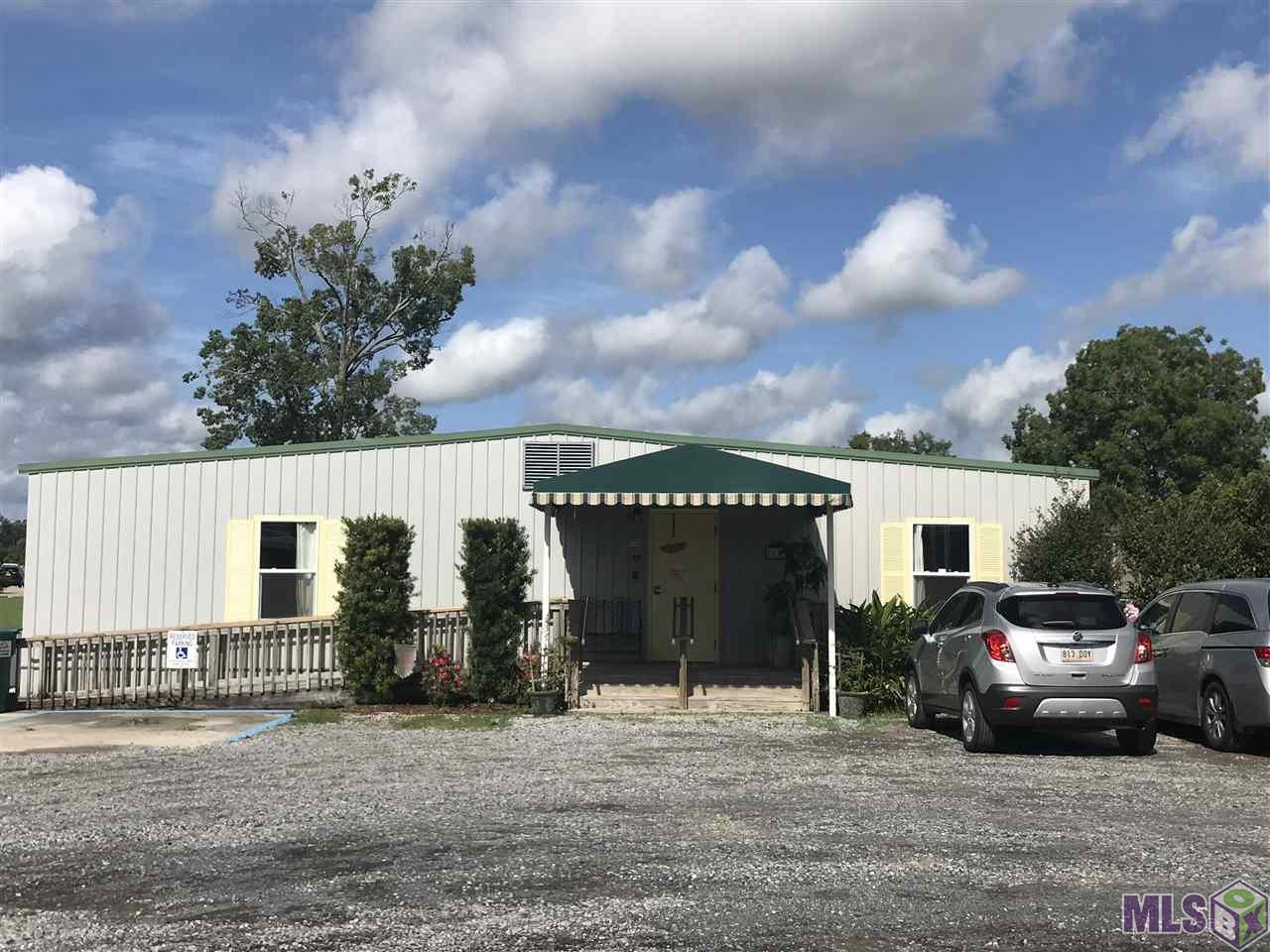 1.54 acres on Old Jefferson Hwy.  Property consists of 3 buildings.  5,400 sq. ft. Daycare, 1,632 sq. ft. Office/House and 3,030 sq. ft. Metal Storage Building.  Daycare is leased out at $3,700 per month with a current tenant.  The house and metal building on the property are vacant at this time.  WILL NOT SELL SEPARATELY.