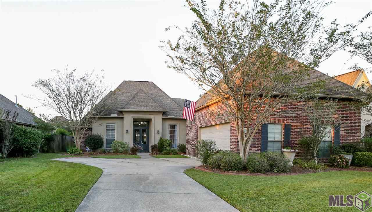 Welcome home to this beautifully landscaped slice of paradise. Minutes from the interstate and Juban Crossing, your access to shops, restaurants, a movie theatre, and top rated schools can't be beat. This 4 bedroom, 3 bath home offers a triple split, open floor plan with formal dining and more storage than you could need. The high ceilings and lots of windows allow for plenty of natural light to fill the home. The kitchen offers beautiful white painted cabinets, an island, pantry, breakfast nook, and a keeping room. You have ample space to entertain and cook with friends and family. The master bedroom has an en suite bath with two large walk-in closets, a separate jetted garden tub, oversized walk in shower and double vanities. Bedrooms 2 and 3 are connected by a Jack and Jill bathroom. Bedroom 4 is across the hall from a full bath. The laundry room is very spacious. The upstairs is a large bonus room, perfect for a game room, movie theatre, or even another bedroom if needed.  The amenities keep flowing to the outside with a covered patio with outdoor kitchen, an additional pergola and a secret garden. The backyard is a retreat all in of itself.  This is one you need to see in person to appreciate all it has to offer. DID NOT FLOOD!!! FLOOD ZONE X!!!