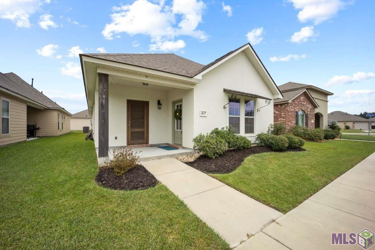 Beautiful, like new home, located in popular Pelican Lakes Subdivision! The perfect location in Baton Rouge, just a quick drive to shopping, grocery stores, eateries, parks, Arlington Marketplace, and LSU. The neighborhood also offers a fitness center, Clubhouse, sidewalks, lakes, dog park, and a pool! This 4 year old home features the Caesar floor plan with 3 bedrooms, 2 bathrooms, 1,812 of living square feet, and sits right across the street from the lake and within walking distance to the Clubhouse. As you arrive you will notice the welcoming curb appeal, fresh mulch, landscaping, and picture perfect front elevation. Upon entering you'll first notice the vaulted ceilings and wide open floor plan. The spacious living room is open to the kitchen and dining room and offers ample natural light through out. Durable, waterproof, vinyl flooring in living, dining, kitchen, and hallway. The kitchen features a huge island, slab granite countertops, stainless steel appliances, gas stove, window over the sink, plenty of cabinets and counter space. Down the hall, you'll find the spacious master bedroom and master bathroom featuring slab granite countertop, two sinks, separate shower, garden tub, and a HUGE master closet. Two spacious bedrooms are on the opposite side of the hallway. The large second bathroom also features slab granite countertops. Two car garage at the back of the home. Covered patio is perfect for relaxing, entertaining, or your morning coffee. Low maintenance home that has been impeccably kept! Call/text for your private showing and make sure to view the virtual tour.
