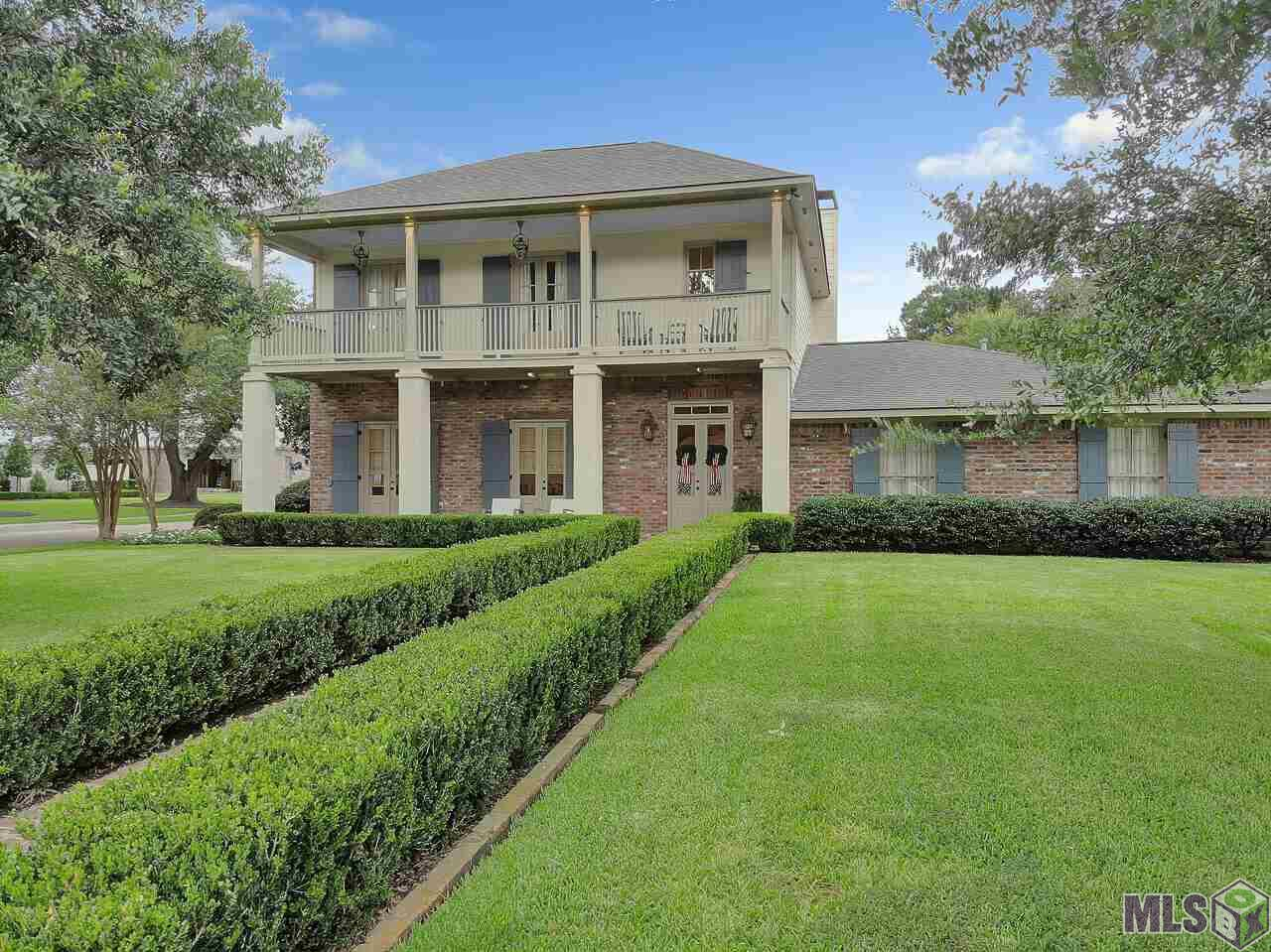 Welcome to Southern Living at its finest!!!  This exquisite 5BR/4.5BA has all the southern charm, elegance and amenities of your dream home.  Home was originally built in 1955 but has been transformed to true perfection.  This home has heart of pine floors, Old St. Louis brick, antique pine beams, gourmet kitchen, living room, formal dining, breakfast area,  powder room, walk in laundry room with sink, kids den and so much more. The elegant kitchen was updated with 3cm Quartzite counter tops, Marble back splash, custom cabinets, large island, Thermadore built in refrigerator, double dishwashers, 48 inch DCS grill with griddle, a total of 3 ovens, warming drawer and walk in pantry.  Living room has antique beams, brick gas fireplace, Old St. Louis brick floors and spectacular views of the backyard, pool and guesthouse. Upstairs you will find the spacious master bedroom, master bathroom and his/her closets.  Additional guest bedroom upstairs with private in-suite bathroom.  Downstairs has three guest bedrooms all with heart of pine wood floors and 2 full bathrooms.  In 2013 the pool and guest house were added.  Every details of perfection from Pennsylvania Blue Stone, Old St. Louis brick accents, Gunite Pool along with a 290 sq. ft. gazebo with outdoor kitchen, fire pit and pizza oven. The guest house is 645 sq. ft.,  with tumbled edge travertine, antique beams, full living room, separate bedroom , bathroom and kitchen.  In 2008 a car lover's dream garage was added.  Yes, you can park  a total of  7 cars in covered, air conditioned space.  Built in work bench with storage and outside restroom make this the a car lover's dream. Finally, home has exterior lighting and irrigation throughout. See attached amenities sheet for more details.