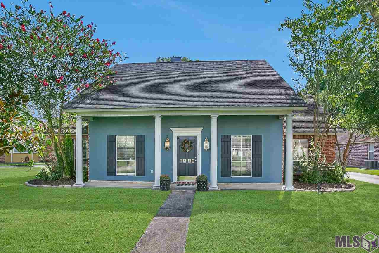 This Acadian style beauty sits on a large lot and is just minutes from LSU!!! Fresh exterior paint in a stand out color scheme creates one of a kind curb appeal. Owner's attention to detail can be seen in the many updates and upgrades. Soaring ceilings, gorgeous triple crown molding and beautiful hardwood floors can be found in the foyer, living and dining rooms. The large living room is perfect for entertaining and features a wood burning fireplace and built-ins for added character. Natural light beams in from the full wall of trimmed windows. Inside this modern styled kitchen you will find an eat-in bar with granite counter tops, freshly painted cabinets and all stainless steel appliances. If you love to cook, then you will really appreciate the GAS stove! Laundry room is located right off the kitchen along with TWO built in pantries. The second bedroom was fully updated with new flooring, new fan and designer grey walls. Guest bathroom has fresh paint, a ship-lap wall and ample storage. Master bedroom features hardwood floors, a tray ceiling and lots of natural light. Master bathroom boasts high ceilings, double vanities, new faucets and hardware, water closet, separate shower and a soaking tub. Don't miss the massive walk-in closet with built-ins! Entertaining is a dream with the beautiful patio and large backyard. The added brick pavers,fire pit and string lights are ready for those fall evenings to enjoy with family and friends. If you're looking for a stand out house in the perfect location, then look no further!