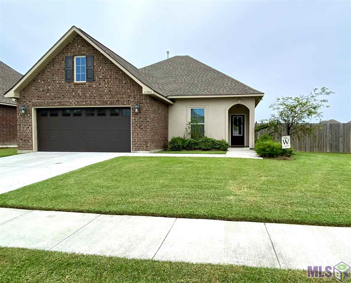 Immaculately maintained 2 year old home! You will love living in the newly constructed Hidden Farms neighborhood. Conveniently located off Old Jefferson minutes from Baton Rouge! This energy efficient home has radiant barrier roof decking, architectural 30 year roof, Rheem tankless water heater, post tension slab, and more! The open floor plan is perfect for entertaining and has tons of natural light! The kitchen features stainless steel appliances, slab granite, HUGE island with bar stool seating, and a 5 burner gas range. All bedrooms are large with walk in closets! There is a designated office just outside the master suite with a granite desk. Large master closet with walk through to the laundry room making life a little easier. Home sits on an extra large fully fenced corner lot! Minutes from shopping, restaurants, medical and more! Schedule your appointment today before this one is gone!!