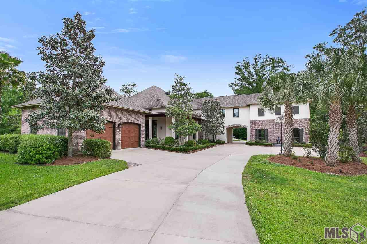 This exquisite National award-winning custom-built home in the coveted and private Highland Road area sits  atop a bluff located on over 24 acres overlooking the lush Louisiana wetlands. Included are four tracts of land  that border Bayou Fountain, along with Lot 11-B-1 in The Bluff Subdivision. Situated on this one-of-a-kind  builder-occupied property are three box stands and a food plot for wildlife viewing or archery hunting.  Surrounded by the beautiful wetlands on three sides, and recognized nationally for its innovative home  automation, electronics and energy- efficiency, the estate includes the main house featuring sky-high ceilings,  energy-efficient Marvin windows providing abundant natural light throughout, gourmet kitchen with over-sized  island, convenient and versatile laundry room, large walk-in pantry, 24-inch travertine tile and hard-wood  flooring, spectacular home theatre, attached screened in area with built-in BBQ and fireplace, resort-style pool  with an island fireplace, and much, much more! Additionally, there are two separate two-car garages, and an  attached private pool house. Currently used as a modern office, this wonderfully designed amenity includes a  spacious living area, full kitchen, three versatile rooms, and a full bath, allowing it to easily be utilized as a  separate private living area, or both! Located at the rear of the estate is a detached shop with a three-car  garage along with a spacious detached shed. The home is set in Zone X, and the surrounding wetlands are in Zone AE. Beauty, Privacy, Versatility, Ingenuity...this fabulous property has  it all! -Schedule your private showing today!