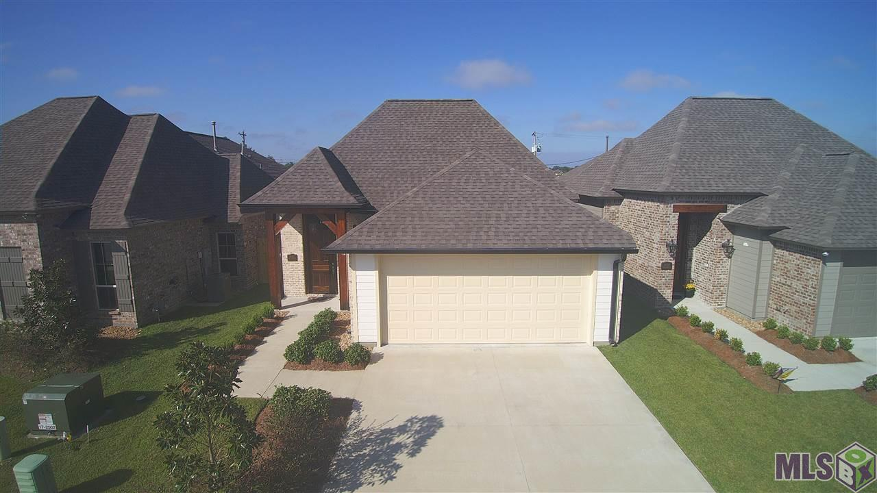 This beautiful Corbin Ladner custom home is a true beauty. Located off Hwy 44 in Prairieville, this home ahs a ton of custom wood working and craftsmanship. Home was built in 2020 in July and still has new home warranties with it. Full appliances come with it, along with gutters, a fence, and window treatments for the heat!