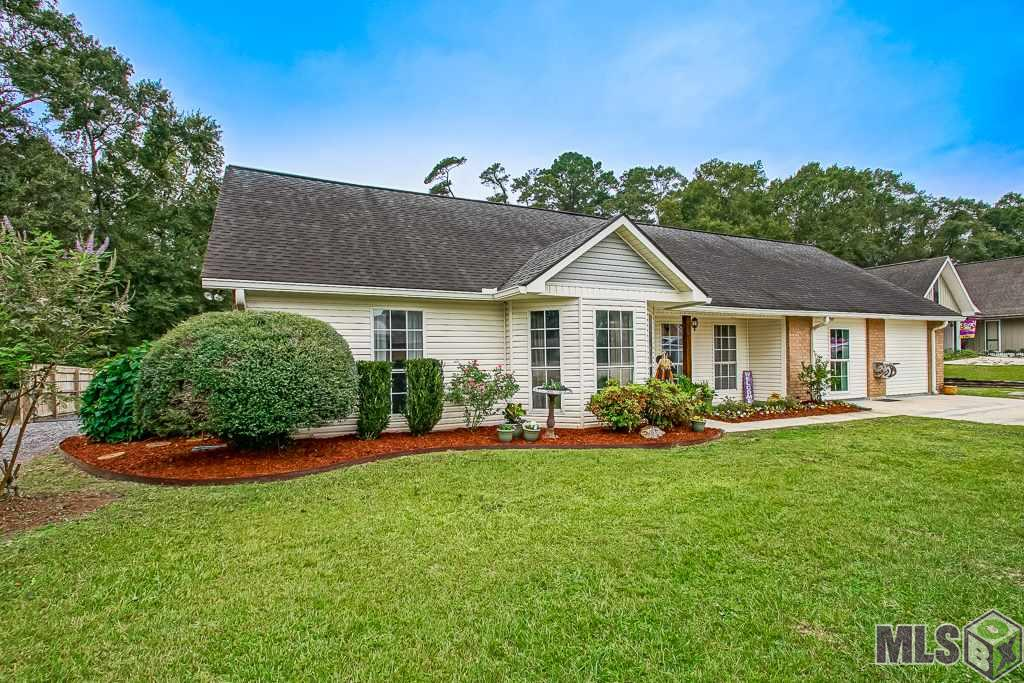 YOU Definitely don't want to MISS out on this beauty! This highly desirable river community has so much to offer. Home is nestled in a fabulous river community with so much opportunity at your fingertips. Located in top ranked Ascension Schools but convenient to Baton Rouge and most shopping. This home has many upgrades and so much space. From the moment you drive up the meticulous landscaping invites you in. The kitchen features updated subway tile, granite counter tops, new cabinets, and loads of storage space. The large functional space off the kitchen has endless possibilities from formal dining, keeping room, sun room, second family room? You decide! OH and MY favorite--ALL THE WINDOWS LINING the entire back overlooking the HUGE backyard and amazing outdoor entertaining space. The master bedroom will definitely not disappoint. Check out the size of the room. Step into you updated master bath with custom surround oversized tub, granite counter top, and his/her closets. The home has a split concept with a separate area having 2 sizable rooms with a brand newly renovated Hollywood bath. Step outside the back and enjoy your covered entertaining area as well as the open patio while grilling with friends. This space featured shiplap and tin roof accents that creates the perfect environment for game day parties. The kids will have endless possibilities with the huge backyard. The man of the house will enjoy the large outdoor storage. Put your boat in the water and enjoy a day on the river as you are only  1 mile from Fred's on the River restaurant and public boat launch.  This home is very affordable with low flood insurance premiums. The neighborhood has a voluntary option to join the private boat slip club at the end of the road with includes covered boat storage and a private boat launch.  CALL TODAY FOR YOUR PERSONAL SHOWING.