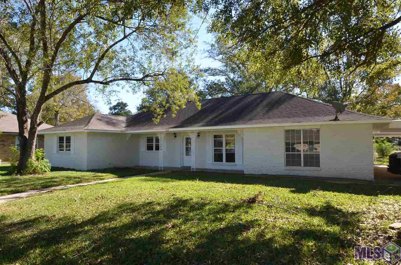 Home has been renovated.  Newer cabinets, countertops, flooring , roof and paint. Corner lot and fully fenced. Large garage and additional covered carport.