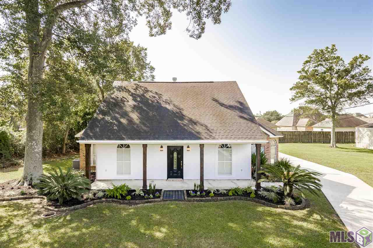 This beautifully updated, renovated, and remodeled home has been so well maintained and meticulously cared for by one owner who has owned it since it was built.  You must see this adorable Acadian Style home with a beautiful front porch that is conveniently located just minutes from the I-10 at Hwy 73 in Prairieville, minutes from the Dutchtown schools, & minutes from Airline Hwy!   This desirable home can be considered a 4 bedroom, 3 bath or a 3 bedroom, 3 bath home with a large bonus room on the second floor with closet, full bath, & lots of space for whatever its new owner needs.  The upstairs bonus room could be a media room, office, sewing & craft room, game room, playroom, mancave, or 4th bedroom.  The options are limitless!  Crown molding, cathedral ceilings, his/hers closets, his/hers sinks, separate shower and jacuzzi tub, stainless appliances, updated colors, fresh interior and exterior paint, updated fixtures, lighting, & can lights, no carpet, no HOA, no flood zone, no flood insurance required, home did NOT flood, & ideal location convenient to Baton Rouge or New Orleans!  Home is currently zoned for the popular Dutchtown Schools!