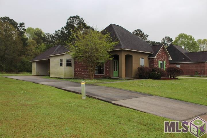 Move in condition. New electric stove and MW hood. Open floor plan with dining area, living room with FP, rear carport with attached storage.