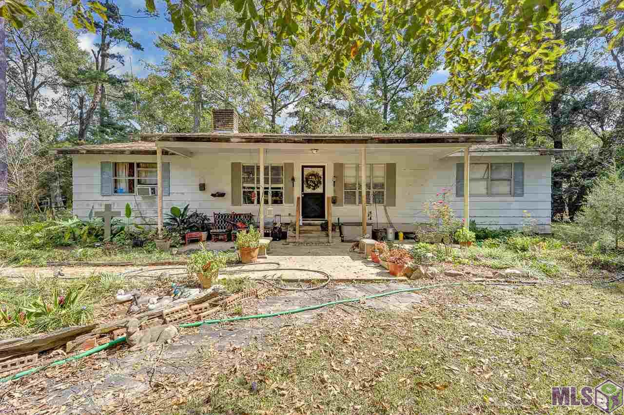 Investors, come take a look at this income potential property! A little elbow grease and love could restore this country charmer to its former glory. The possibilities are endless with the layout of 1.77 acres, boasting beautiful magnolia and pecan trees on cleared land. Potential to make this anything you want it to be! Home did not flood in 2016 and does not require flood insurance. Grab it before someone else does!