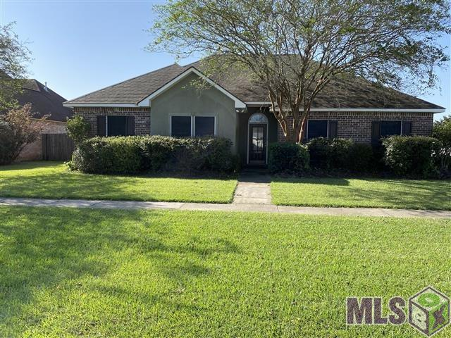 Must see! Open layout with tall ceilings, formal dining is a great flex space, crown molding & fireplace! Sunny breakfast area and spacious kitchen! Tile & wood floors throughout common & wet areas. Large laundry room with utility sink! Fenced lot & covered patio! Huge storage closet in carport!