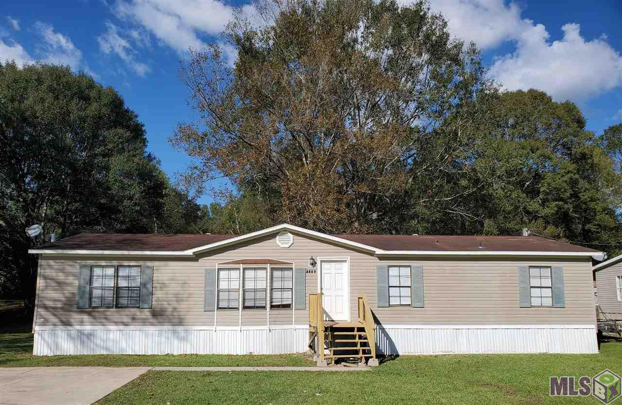 Great 3 Bedroom 2 Bath mobile home located in Zachary on almost a half acre! This home has been freshly painted, no carpet and new countertops in the kitchen. The master bathroom has a large garden tub with a separate shower! Plenty of yard space! Zachary School District! Mobile home did not flood in 2016. Schedule a tour of this home today!