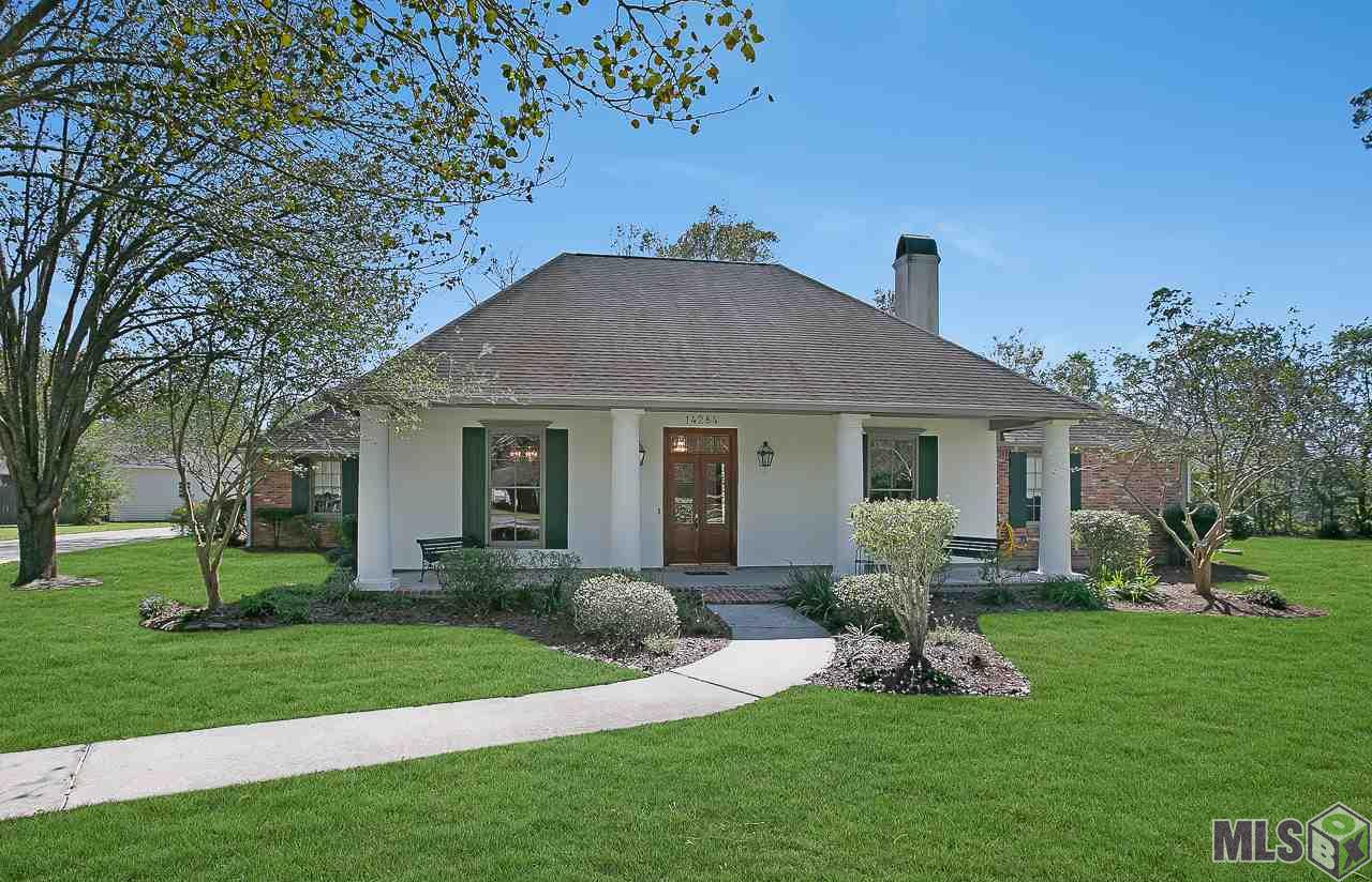 Walking up to this spacious home you will be greeted with gorgeous landscaping and stunning curb appeal. This porch is a peaceful place to sit and enjoy the landscaping. This home was inspired by A Hays Town and the details throughout are amazing. The living room is spacious with refinished, authentic pine wood floors, built in cypress cabinets and bookshelves, and a custom cypress mantel over the fireplace. The kitchen/keeping area features so many custom details including bead board ceilings over the sink, cypress cabinets, 5 cypress beams, granite counter tops, stainless appliances including a trash compactor, authentic brick floors, computer nook and custom cypress mantle over the fireplace. The master is truly a retreat with private access to the patio and an en suite bath. The bathroom offers a separate shower, jetted tub overlooked by a beautiful stained glass masterpiece, and large walk in closet.  All bedrooms have large walk in closets and a large linen closet in the hallway. Crown molding is throughout the entire home with some windows and door frames featuring fluted casings. The backyard is a breath of fresh air with a small fenced in area including a pergola with fruit trees throughout the yard.  An added bonus is a large boat shed 11 X 23 and a separate Workshop 15 x 23! Immaculate home sits on .78 acre at the end of a dead end street making it a private and secluded retreat.