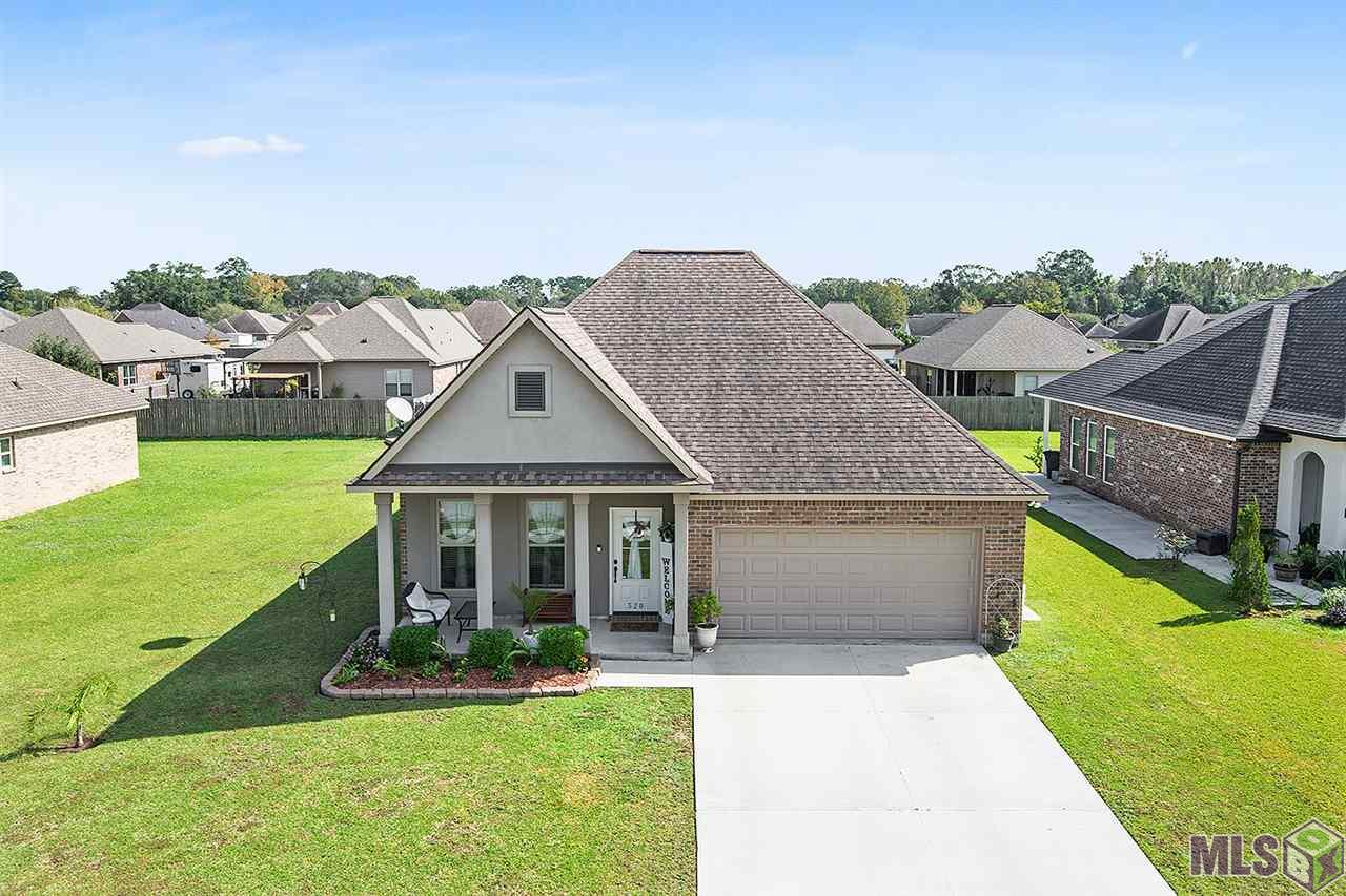 This immaculate 4 bedroom home is conveniently located to Tanger Outlet, restaurants and tons of stores!  Located in Grand View Subdivision, this home has been very well taken care of with a list of upgrades!  Laminate wood floors in all   bedrooms, an extended back patio with 2 sunshades, stainless steel backsplash in the kitchen, a stainless steel vent hood, updated light fixtures, hard wired internet cables in all bedrooms, and so much more!  This home is a rare find!