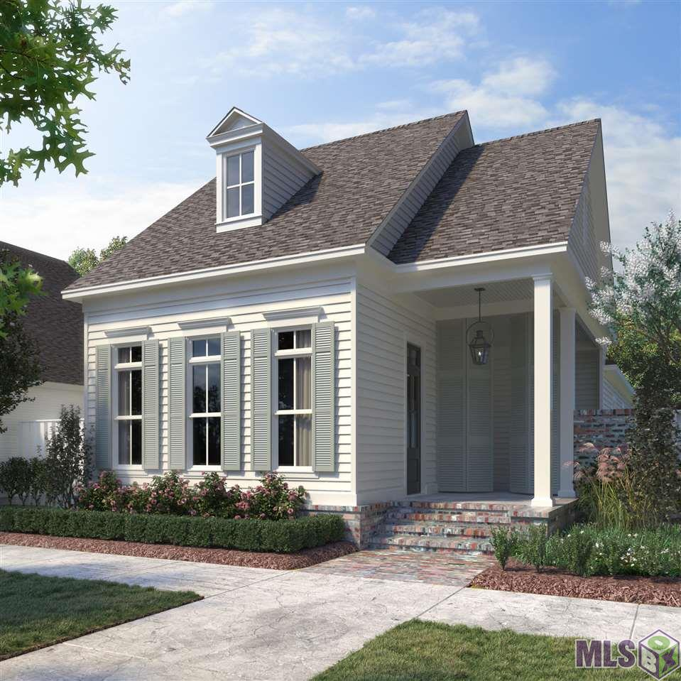 "Custom built by Rabalais Homes, this Chelsea plan is set overlooking one of the open green spaces within The Village at Conway. The lovely front porch greets and as you enter the home, you'll notice the gathering room banked with a wall of windows at the front of the home, allowing for plenty of sunlight. The fireplace with quartz surround creates a focal point for this room. The kitchen is open to a dining space with access to the side courtyard via French doors. The kitchen features an oversized island with quartz counters and built in stainless appliances. Wood floor begins when you enter the home and is continued through the kitchen and down the hall and into the owner's suite. Here you'll find a spacious private retreat opening to a bathroom made for relaxing. The owner's bath has a stand alone tub, oversized, glass enclosed shower, and a custom lighting package that finishes it perfectly. The owner's closet is over 100 square feet, ample space for all your wardrobe and storage needs. The two secondary bedrooms are inset away from the owner's suite for additional privacy and both open to the shared guest bath. This thoughtfully laid out plan also includes an office space for the days you prefer to work from home. The courtyard is prepped for an outdoor kitchen and includes an extension so no space is wasted. 20 minutes outside of Baton Rouge, 45 minutes outside of New Orleans, come see the green spaces, wide lakes, walking trails, and why Conway is ""Living Made Easy"". Not located in a flood zone, estimated completion January 2021. Call today for your private tour of the custom finishes included in this home."