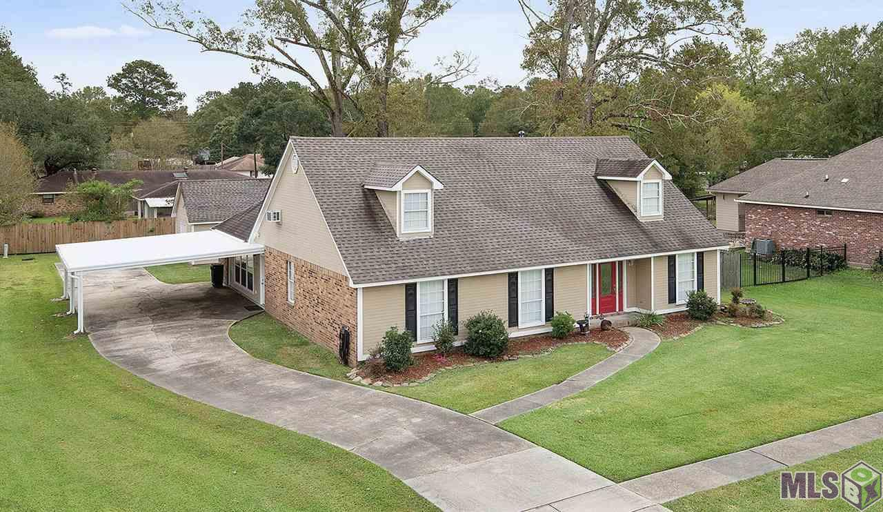 """Motivated Sellers! This is a Must See!  Beautiful custom built home in top rated Zachary School District.  A short walk/ride to Fennwood Country Club/Golf Course!  Nice quiet neighborhood. This fabulous two-story home features a stunning kitchen with slab granite counter-tops, oak cabinets, five burner gas cook-top in large island, and spacious double ovens for all that holiday cooking. Convenient large walk in pantry with floor to ceiling custom cypress shelving.  Large family room with windows overlooking the spacious covered patio with outdoor TV hook up. Great for family """"Get-togethers!""""  Renovations throughout. Fresh paint inside and out. Awesome game room with wet bar and convenient French doors opening to the patio when entertaining. Four large bedrooms, plus office. Two large, full baths and master bedroom with en-suite.  Detached 16 x 21' workshop with air condition and covered porch.  (508 sq.ft.- built in 2011).  Must see! Great house!"""