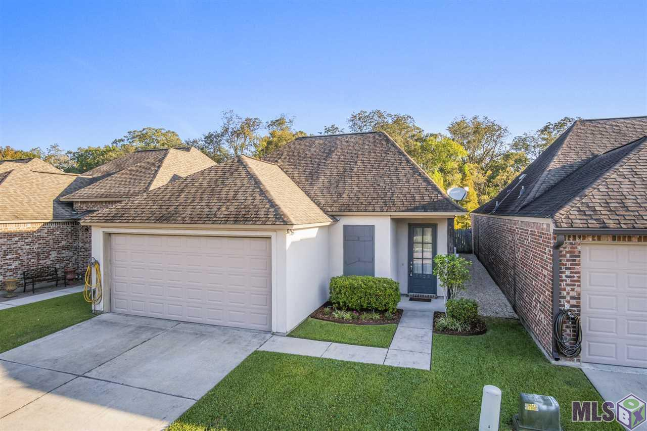 Waterfront home in the highly sought after gated community of University Villas. Enjoy evenings on the covered patio overlooking the bayou.This move-in ready house features an open floor plan that provides the perfect place to entertain family and friends. The kitchen features beautiful stained cabinets that extend to the ceiling, granite counters, stainless steel appliances and a large island with a bar. The spacious master bedroom offers high ceilings and waterfront views while the ensuite bath has dual vanities, jetted tub, separate shower and a large walk-in closet that connects to the laundry room. University Villas, located minutes from LSU, is known for its amenities which include a resort-style swimming pool with fire pit, clubhouse that can be rented for special occasions, and a ¾ mile walking trail around the main lake.