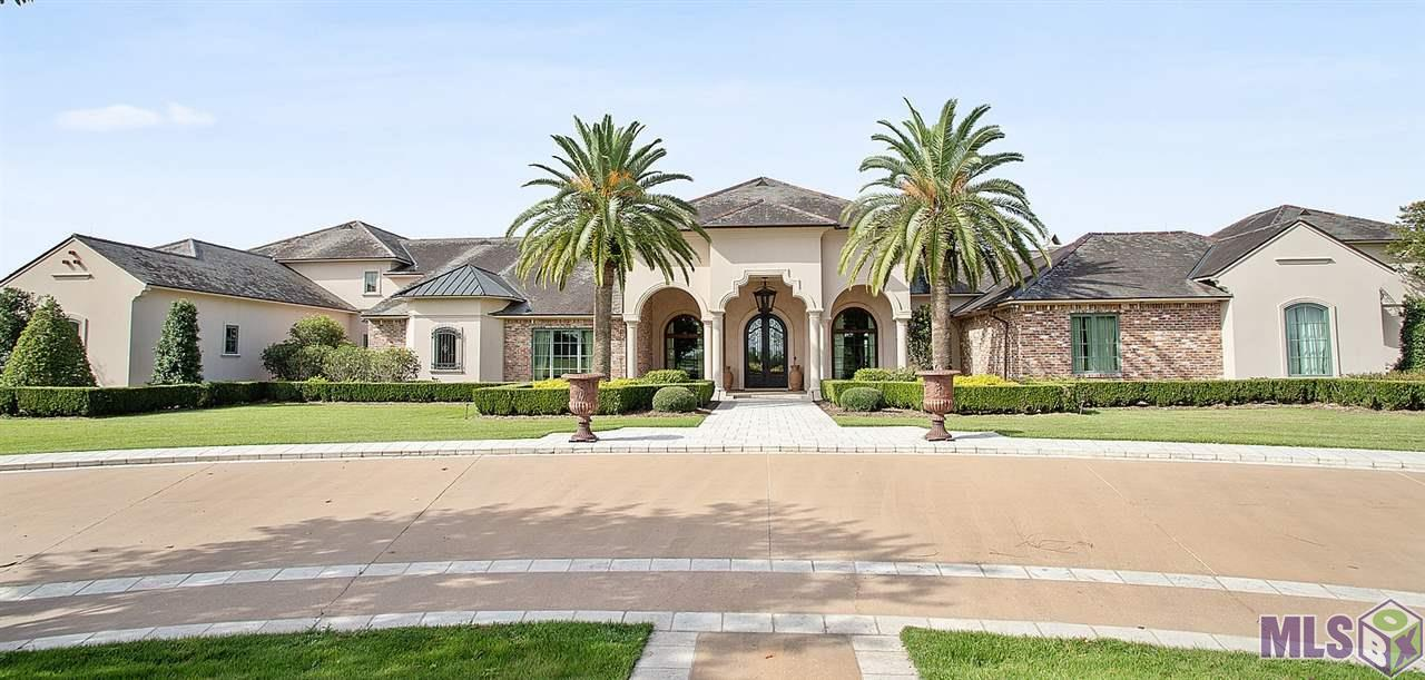 This magnificent private estate consists of 59.39± acres of land enhanced by a 13,357± square feet of incredible quality living area.  An entrance gate to Mallard Lakes in the front of the community plus a brick/plaster and wrought iron entrance gate with guardhouse to enter this property.  There is extensive wrought iron perimeter fencing. The land forms a peninsula, with Mallard Lake wrapping around the northeast and a private pond on the southwestern portion of the site. The sunsets are incredible!  The home has a supersized garage and extensive open porches. You will not believe the spectacular 7,440 sq. ft. barn with 1080 square foot loft apartment plus caretaker bedroom and bath.  The main house is designed for a large gathering or a small intimate one either indoors or out.   Fabulous indoor/outdoor relationship in the rear overlooking the beautifully designed pool with the lake in the background.  Enjoy the outdoor kitchen for alfresco dining.  Old beams accent the main areas. Formal study/library with European stone fireplace with beautiful views. Massage room with sink plus a workout room. Intimate temperature-controlled wine room plus a tasting room. Theatre Room with leather reclining chairs, surround sound projector and acoustical sound proof walls. Domed ceiling in the formal dining room. Upstairs guest area with kitchen.  Large room for seasonal storage/hobby room with gift wrapping area off the game room.  Walk in closets in every bedroom. 8 HVAC systems. Irrigation system around property plus much more! Priced at appraisal.