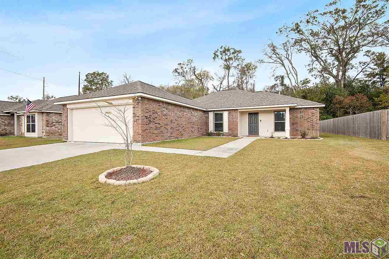 100% Financing Eligible!! Better than new!! Perfect open floor plan with all of the amenities…..Close to Ascension parish schools, great restaurants, shopping, and convenient access to Airline Hwy. This 3 bedroom 2 bath home features an open floor plan. Laminate wood floors throughout the home (NO CARPET!!). The kitchen has granite counters, stainless appliances, and a center island that overlooks the entire living space. This home offers a desirable split floor plan with the master bedroom on one side and the other two bedrooms on the other side of the house. The master en-suite features a large soaker tub, separate stand up shower, his and hers vanities, and a large walk-in closet. The backyard faces the tree line with planter boxes for gardening. This home has been immaculately well kept and won't last long .  No flood insurance required!  Call me today to schedule your private tour!