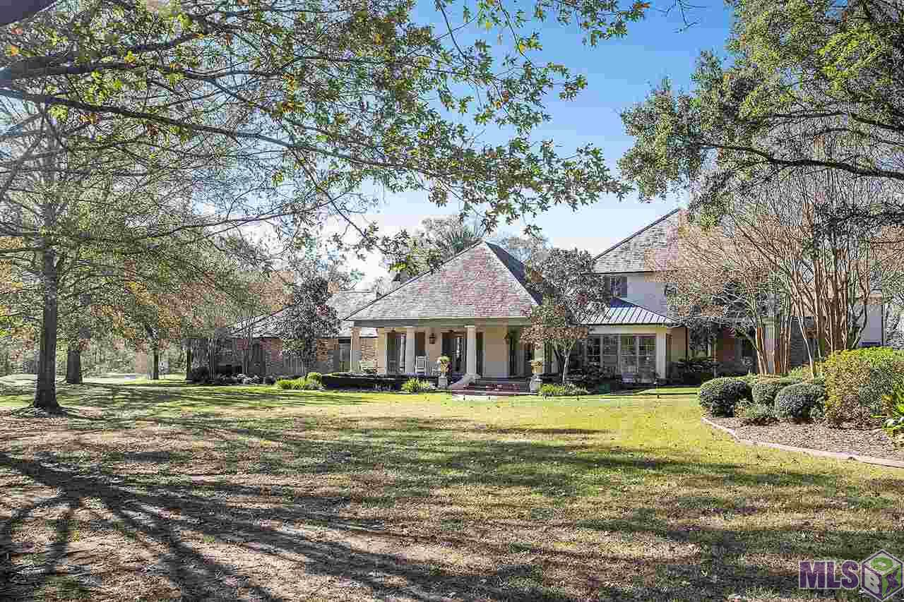 """The """"crown jewel"""" of The Country Club of Louisiana is carved out of a dead-end street and is privately gated. This 5.3-acre estate consists of additional lots already subdivided and approved as entire parcel.   Enjoy the magnificent views of the Jack Nicklaus golf course while remaining private! This one-of-a-kind estate has absolutely every top of the line amenity, curb appeal like no other, and a set back sprawling facade including balconies, stucco/old Chicago brick materials, and a slate roof.  The masterpiece garage accommodates 7 cars, is custom fitted with cabinets and the 7th bay is air-conditioned. The sophisticated entertaining area is Architectural Digest worthy! Recently added is an amazing pool, hot tub, accent columns with fire, fire pit, quality stone paving, multiple seating areas, and a large outdoor fireplace. The adjoining pool cabana is surrounded with electric screens, and has a fireplace and outdoor kitchen. The adjoining pool room is great as a guest suite or entertaining area. Attached are night shots showing fire and water features, drone photos to view entire estate, and interior photos."""