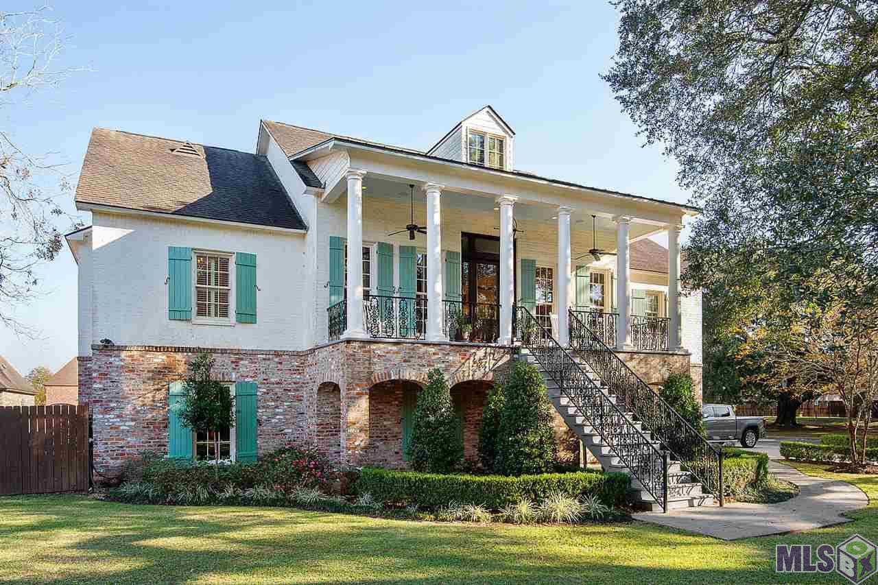 Old New Orleans charm with all the modern amenities of a new home! Truly exceptional 2011 custom built raised Southern Greek Revival Home sitting on nearly one acre in Ascension Parish with 300+ year old Live Oak tree overlooking beautiful Bluff Road. Stunning entryway with custom 10ft solid Spanish Cedar door to second floor main level which opens to soaring 12ft ceilings and triple crown moulding. Custom woodworking on all cased openings and doors throughout home. Home boasts beautiful archways, exposed brick, solid wood doors, wood windows and cypress floors throughout main level. Fabulous Chef's Kitchen with marble countertops, all stainless steel appliances including commercial True refrigerator and freezer, Jenn-Air 6-burner gas cooktop/double ovens, Jenn-Air double dishwasher drawers, Jenn-Air refrigerator/freezer drawers and deep, custom built walk-in pantry. Large master suite which includes master bath with double marble top vanities, clawfoot tub, walk-in shower, porcelain tile floor with attached custom built closet and laundry room. Plantation Shutters in all main floor bedrooms and master bath. Bose Audio System throughout home! This home is perfect for entertainers, sports or party enthusiasts and those hosting friends and family. 3BR/3BA on 2nd floor main level. Downstairs has additional 2BR/1.5BA PLUS home theater, playroom, exercise room, and game room with wet bar. This area is great for guests or can be a mother-in-law suite. All interior doors are handicap accessible with a home elevator. 4 car garage, one side built to accommodate a 24ft boat. Civil War Era brick on lower exterior of home from Danville, VA. Painted brick upper with wrought iron grand staircase, gas lantern and balcony. Fully-functional cypress shutters on all exterior windows. Large, completely fenced backyard with natural gas and water hookups ready for your outdoor kitchen. Dutchtown School System. Schedule your appointment today. Serious inquiries only, please.