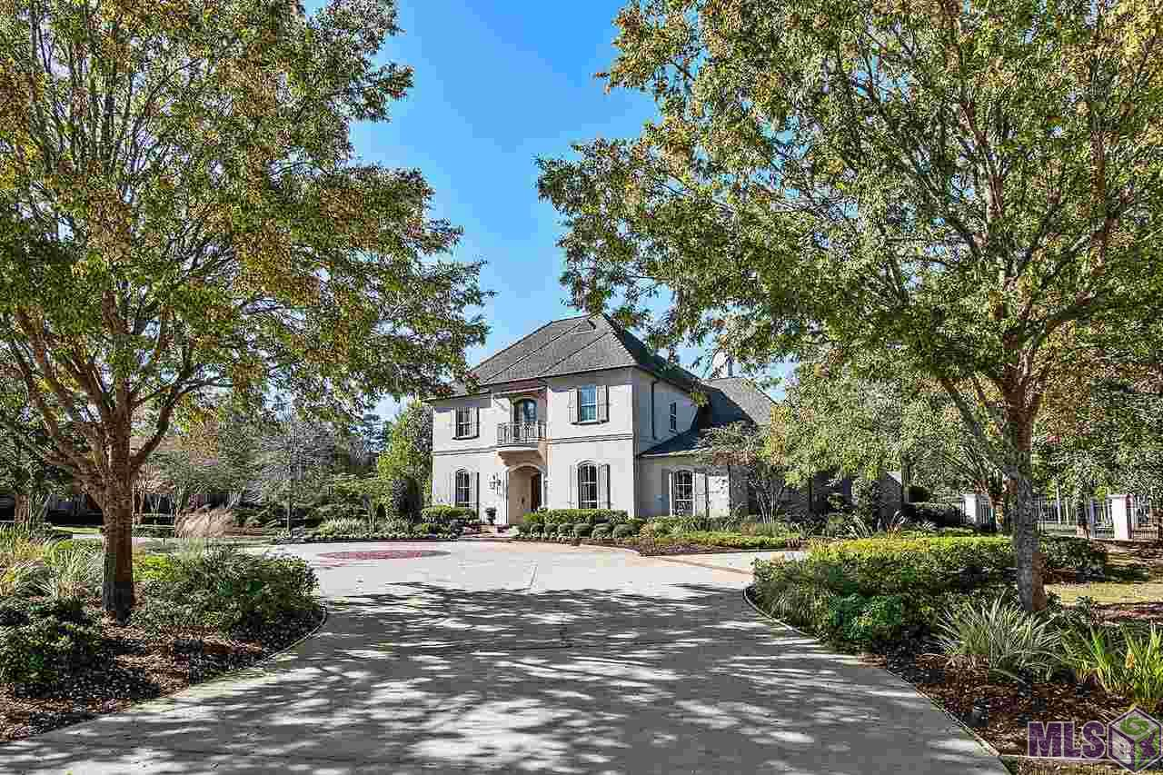 Elite LUXURY!!! Nestled on nearly2.5 Acres inPrestigious Gated Community only 15 minutes to Baton Rouge and 40 Minutes to New Orleans! This beauty has been featured on HGTV and is nothing short of SPECTACULAR! A collaboration of renowned Designers & Architects have brought this one to LIFE with exquisite detail and no expense spared. Now is the chance to make it yours! This one absolutely has it ALL... 6 Bedrooms, Home Theater, Recreation Room, Pool & Spa designed by Eduardo Jenkins and Built by GW Oliver. There are far too many features to list, so here are the highlights: Beautiful Walnut Kitchen cabinets, Closets, Pantry, & boat port storagedesigned by Inspired Closets, Wolf 6 Burner Gas range with Griddle, Wolf microwavedrawer, warming drawer, Sub Zero Fridge with panel front, TWO Kitchen Aid dishwashers with panel fronts, Bevolo exterior lighting, Dolce Vita Quartzite Counters in Kitchen, Crema Delicato Marble Counters in Master Bath, Laundry Hookups for TWO Washers and TWO Dryers, Double Electrolux Washer & Dryer, Steam Shower in Master, Central Vac System, Control 4 Smart Home, Outdoor Kitchen, Outdoor Fireplace, 3 Car Garage+ additional storage, Fully Fenced & Extensively Landscaped for Ultimate privacy... The list is ENDLESS! Check out the High Quality Video and Professional Photos to see more... Several custom lighting fixturesand some draperies Do NOT Remain... Full list available upon request. Serious Inquiries ONLY