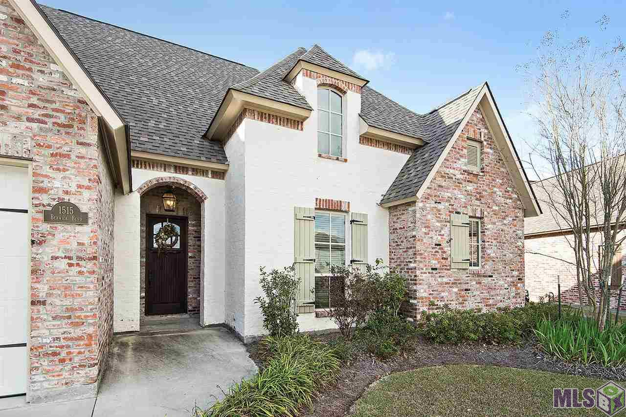 Welcome Home to this STUNNING Custom Built Beauty in Award Winning Copper Mill Golf Community.  This gorgeous home offers 4 bedrooms, 2.5 baths, an OUTDOOR KITCHEN, a LARGE COVERED PATIO and it sits on a VERY LARGE FENCED LOT.  No detail was overlooked in this home including ANTIQUE CYPRESS BEAMS, Old Brick Accent Archway/Wall, wide plank flooring, 8 foot interior doors, 7 foot tall windows, antique beadboard throughout the home and custom lighting.  The kitchen offers stainless appliances including a GE Monogram cooktop w/griddle, travertine backsplash, walk-in pantry, large serving island/breakfast bar, convection and traditional ovens and slab granite.  The formal dining has a old pine ceiling treatment and wood flooring.  The large family room features a cozy fireplace with brick surround, built-in cabinetry and a wall of windows to allow in natural light.  The master suite has wood flooring and French doors leading to the spa like master bath.  The Master bath houses a huge 7 foot by 3 foot walk in travertine shower with rainhead and jets, a stand alone soaking tub, dual vanities and large well appointed master closet.  The 3 additional bedrooms are on the opposite side of the home and all offer nice size walk-in closets. You are sure to enjoy entertaining on the large covered patio with an outdoor kitchen including a BULL GRILL and beverage fridge. All window treatments convey with the home. Come and enjoy the lifestyle that Copper Mill Golf Community has to offer...including a family golf membership, tennis and swim membership, Turnberry Park, walking trails, fishing pond and community events!  Located in Zachary School District.
