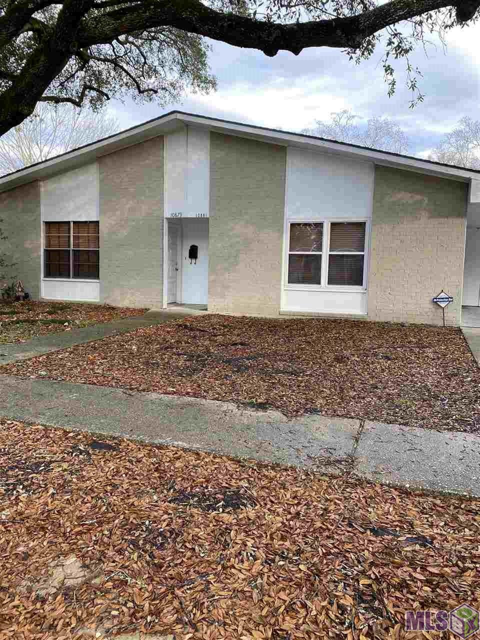 Location, location, location! Spacious 3BR duplex surrounded by huge Live Oak trees and a wonderful community feel. Situated just off Coursey Blvd.