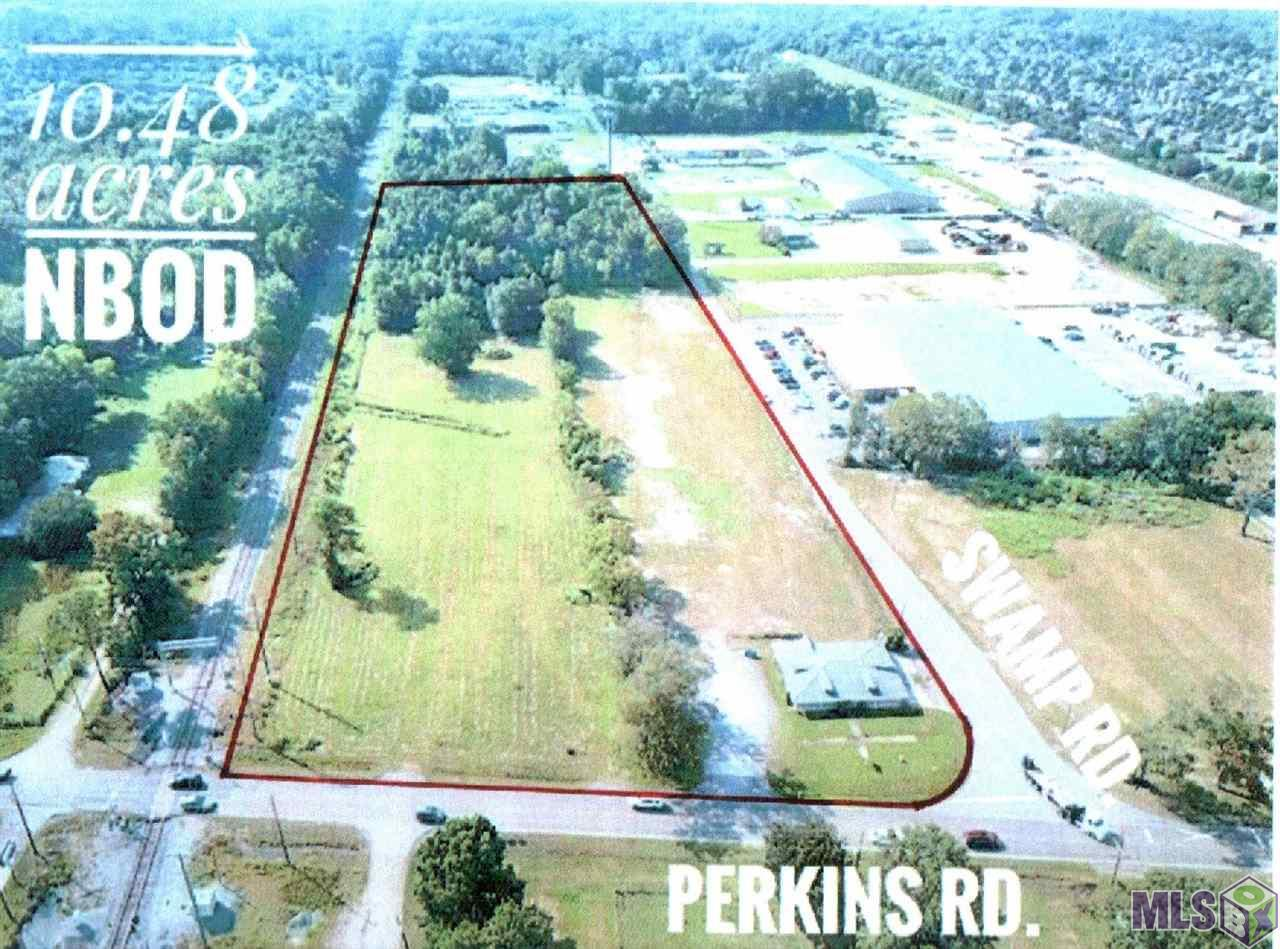 The Last Large Commercial Acreage Tract located at the corner of Old Perkins Rd & Swamp Rd. Zoned LI, Multi-Use Site, Ideal for PUD, Great Dimensions,  High & Dry! Call Office for Info and Plat..