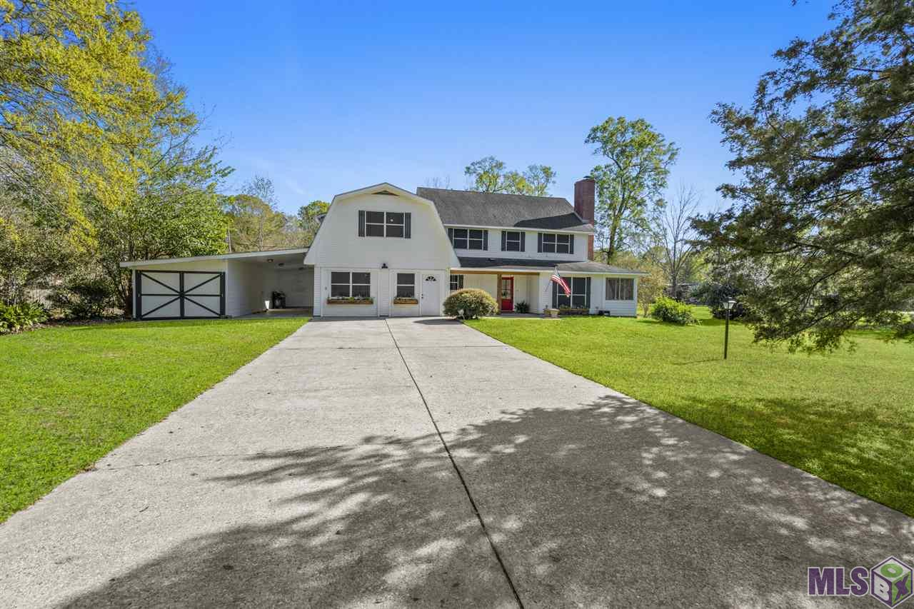 Country living on 2.86 gorgeous acres with mature trees, a workshop, shed and a screened in porch!  This spacious home offers 4 bedrooms (the 4th bedroom being a fully functioning apartment of 357 sq ft that is NOT included in the living square footage)and  3 and a half baths.   The kitchen offers granite countertops and stainless appliances.  The living room and dining room offer wood floors and views of the beautiful wrap around screen porch. Outdoors you will enjoy entertaining in lovely backyard with a beautiful courtyard area. You will also appreciate the room to roam on this property as well as the 840 sq ft workshop, shed and storage building.  Call for your private showing today! Flood Insurance is currently $1598/year.