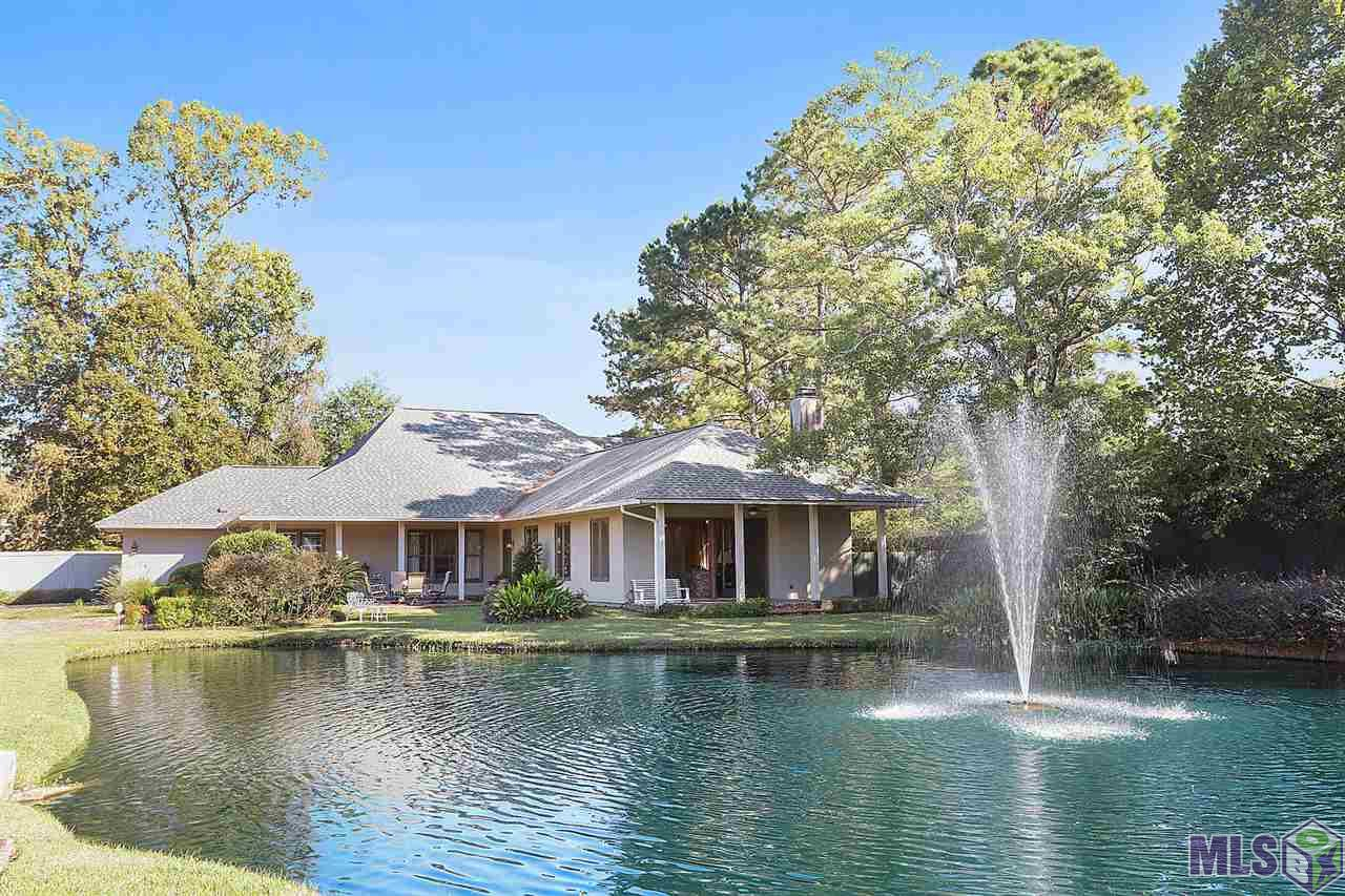 Located in a small gated community, right off of Old Hammond Hwy.  This 3 bedroom & 3.5 bathroom beauty is  located on a Waterfront lot, with a spacious outdoor inground gunite pool, with extra green space for a pool house/outdoor kitchen if desired.  The front porch over looks the waterfront pond, off of the very spacious living room & dining room area.  Chef style kitchen, with a gas range, breakfast room & granite bar area, with an additional living room area.  Office space overlooks the backyard pool, with an additional sitting room, & extra office or bedroom area.  Master bedroom has 2 large walk-in closets, plus a steam shower, bath and double vanity, a must see.  Upstairs are 2 large bedrooms each with their own bathroom.  The double garage has a tool room and plenty of storage with shelves, and room for an extra refrigerator or two.  A full house generator located outside before the pool gate entrance, provides extra assurance you will have with utilities when storms hit.  A brick parking pad alongside of the driveway, provides that extra space, if needed.  Make your appointment today, before this one is gone.