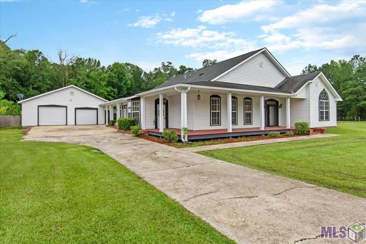 Love to entertain? Love country living? With this home you get the best of both worlds! Located just a short drive from the interstate, centrally located between New Orleans and Baton Rouge. This home features over 5000 sf of living on over 2 pristine acres with a detached guest room and bathroom. As you make your way into the home from the semi wrap porch, you will notice the amount of space right away. The grand foyer is adorned with a beautiful chandelier. To the left of the foyer you will find a nice space for an office or library. You will find to the right a hallway that leads to the two over sized bedroom . You will be delighted with the size of these rooms. As you enter the living room, you will find lots of space with beautiful cathedral ceilings , wood beams, columns and a fireplace.This huge open floor plan has an extremely large kitchen with a wrap around bar with granite counter tops. There is a large walk in pantry with a breakfast area and a formal dining room. The kitchen also has a sun room with a wall of windows overlooking the backyard. Enjoy your nights out on the back deck cooking while watching the kids play a game of basketball on the court or fish in the pond, take note of the half bath out there also. You can venture off to the man cave for a game of pool or to relax and watch the game. There is an extra storage room on the backside of the home. This home is handicap accessible and does not require flood insurance. You don't want to miss out on this one! Schedule your PRIVATE tour today!