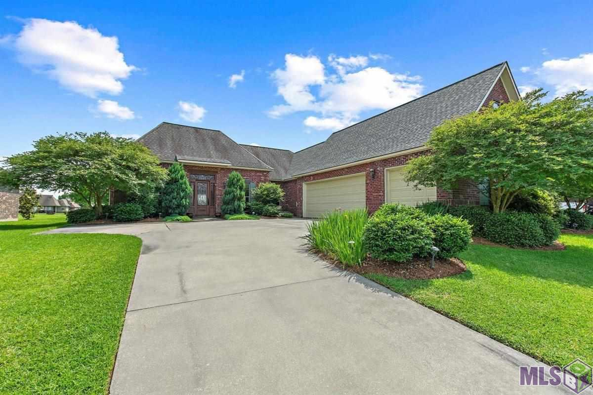Wonderful home on the lake in popular Audubon Lake Subdivision.  This custom home offers 4 bedrooms PLUS an office!  As you approach the home you will love the gorgeous security door built by Ironworks.  The living room has built-ins, a fireplace and a wall of windows to enjoy the gorgeous lake views.  The kitchen has a 5 burner cooktop, wall oven, stainless appliances, a pantry, granite countertops, tile backsplash, over and under cabinet lighting and a island/breakfast bar accented by pendant lights.  The spacious master suite is tucked away for privacy and offers a en suite master bath with a huge closet.  This home offers 3 additional bedrooms all with nice size closets.  The backyard is absolutely gorgeous!  2 pavilions, a large covered patio, a very large uncovered patio with a firepit and luscious landscaping.  This home also offers a 20KW generator and a 3 car garage.  This community offers a neighborhood pool, walking trail area and pool house.