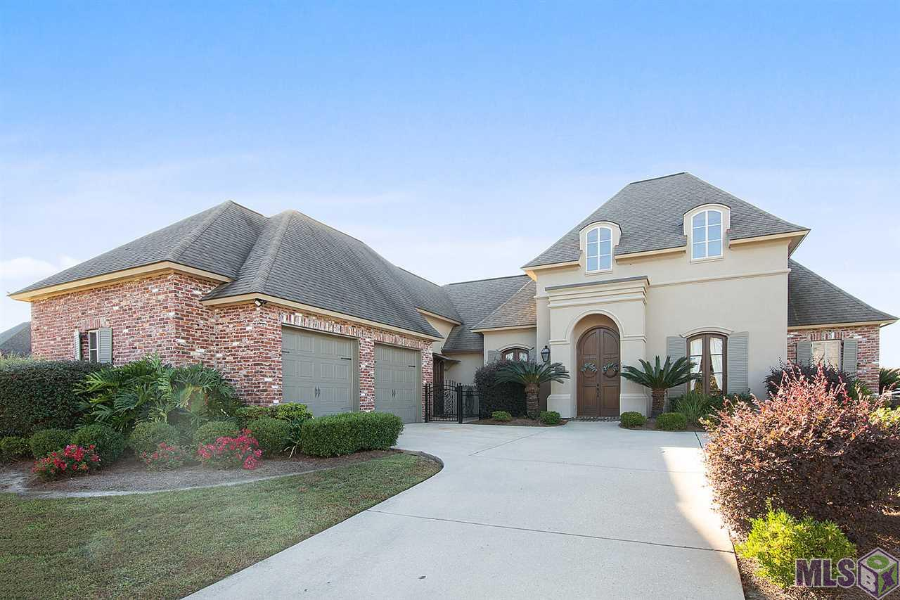 Exquisite 5 bedroom, 3.5 bath home on a corner lot with a heated pool, rock waterfall, spa and whole home generator. As you enter the foyer you will appreciate the open area of the dining/living room/foyer. The large living room offers wood flooring, a cozy fireplace, gorgeous chandelier, built-in bookcases and a wall of windows to enjoy the views of the backyard. The chef of the home will love the large kitchen featuring a oversized island and breakfast bar accented by 2 light fixtures, slab granite countertops, stainless appliances, 5 burner range and double drawer dishwasher. The kitchen also features a butlers pantry for entertaining as well as a desk and keeping area.  Large master suite offers wood flooring, a seating area and backyard views.  Master bath features a large, glass-surround shower, jetted tub, his and hers vanities and his and hers walk in closets.  Triple split floorplan allows for maximum privacy. Down a separate hallway are two bedrooms and a jack and jill bath. 5th bedroom could be used as an office. Guest suite with access to a full bath is privately located off of the kitchen.  Outside features lush landscaping, Arizona flagstone accented gunite pool with a waterfall, hot tub, slide and fountains for relaxing afternoons with friends and family.  Pool was re-gunited and automated this year.  This home has a whole home generator for peace of mind as well as convenience during bad weather. Oversized garage with a small workshop offers plenty of room for storage. Tons of upgrades.  Enjoy all that Copper Mill has to offer: family golf membership, community swimming pool, tennis courts, Turnberry Park, fishing ponds, walking trails.  Call today for your private tour.