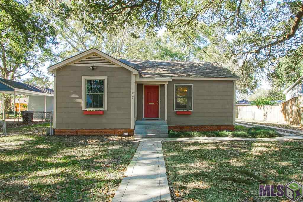 You won't have to do a thing but move right in and start enjoying this cozy Mid City cottage. You will love the open floor plan with large kitchen that has  more than enough counter and cabinet space. The roomy utility room is off the kitchen and has even more storage. Both bedrooms are very spacious and have nice sized closets.  Just a few of the many other features this cute home has to offer are the gorgeous wood flooring throughout, new windows, and the big, fenced back yard with outside storage. All this and much more, sitting on an oak shaded lot in the heart of Old South Baton Rouge, just a few minutes from all the local shops and boutiques  Mid City has to offer, Towne Center, downtown, BRCC, LSU, interstates, and just about everything else! You must see this home for yourself.