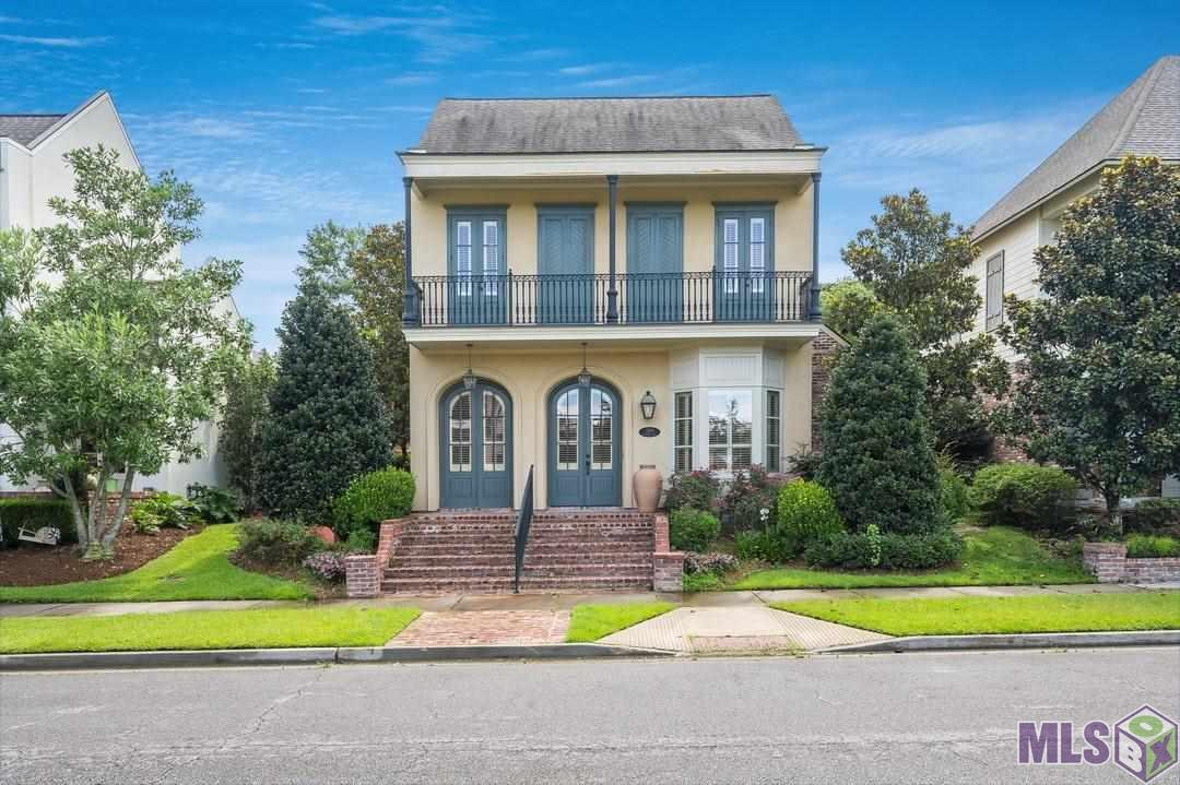 This beautiful home boasts a New Orleans flair and is located in the sought after Village at Magnolia Square in Central.  Inside you will find an entertainer's dream with a wide open floor plan, lots of natural light, and a large dining and living room! The kitchen is gorgeous with intricate millwork, exotic granite, an upscale gas cooktop, a pot filler, lots of storage and a large walk in pantry! The hand-scraped hickory floors are stunning and each window is covered with custom plantation shutters. The master bedroom and bath are spacious and feature a fantastic Master Closet with a pass through to the laundry room!! Two additional bedrooms downstairs are large and share a Jack and Jill bath.  Climb the stairs to find even more.  At the top, you will find a bonus, media room, additional bedroom and bathroom complete with a private front porch balcony! The neighborhood is wonderful and allows walkability to an upscale Steakhouse, a salon and spa and more!  Don't miss out on this one!