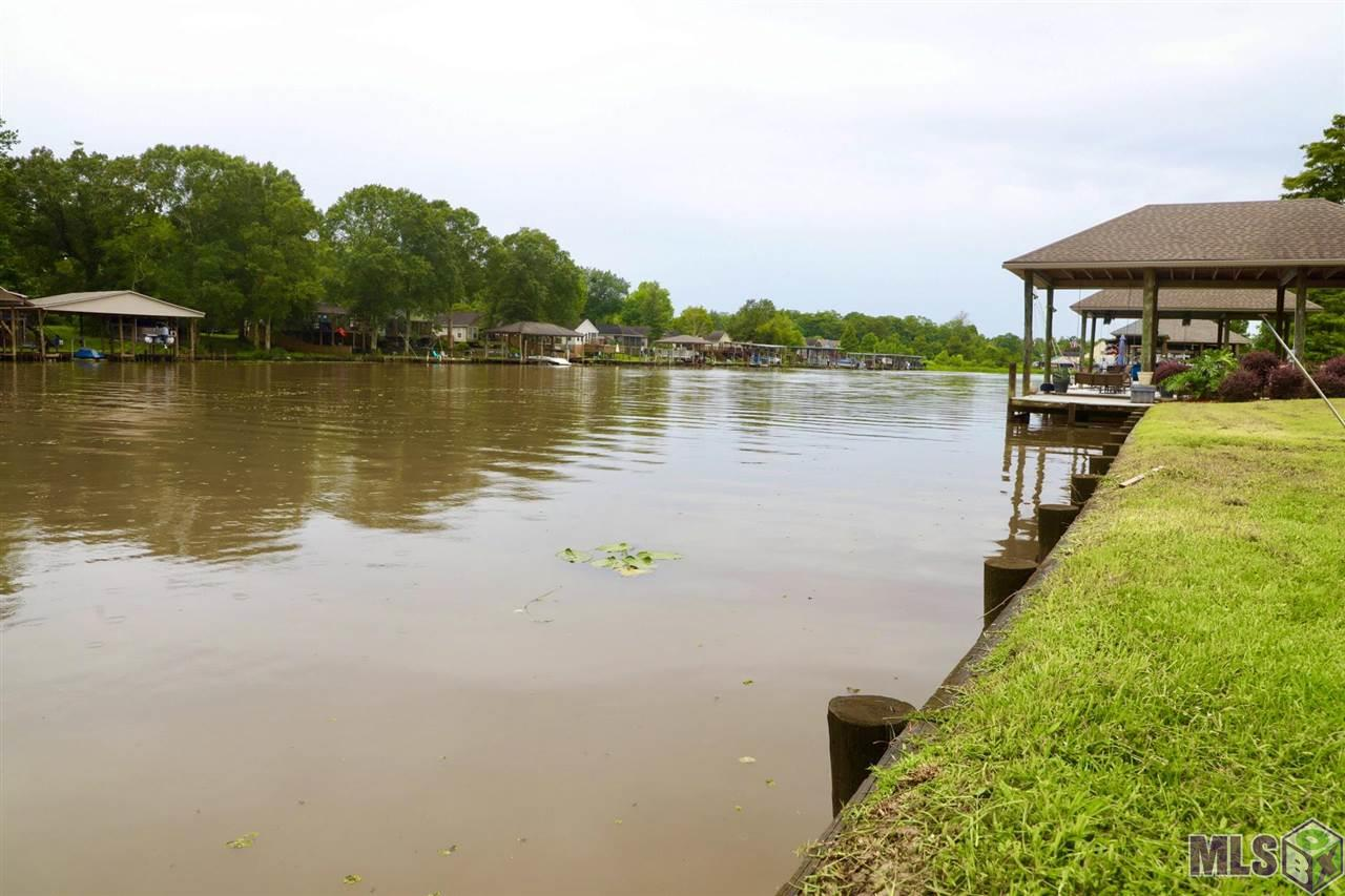 Beautiful waterfront lot in the popular gated community of Waterfront East.  This lot, offering 50 feet of water frontage, allows boat access from the Diversion Canal to Lake Maurepas, Lake Pontchartrain and out to the Gulf of Mexico.